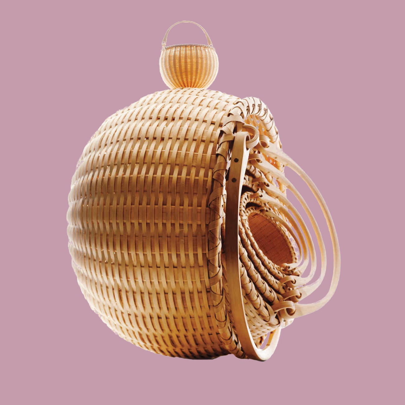 wicker baskets on pink background