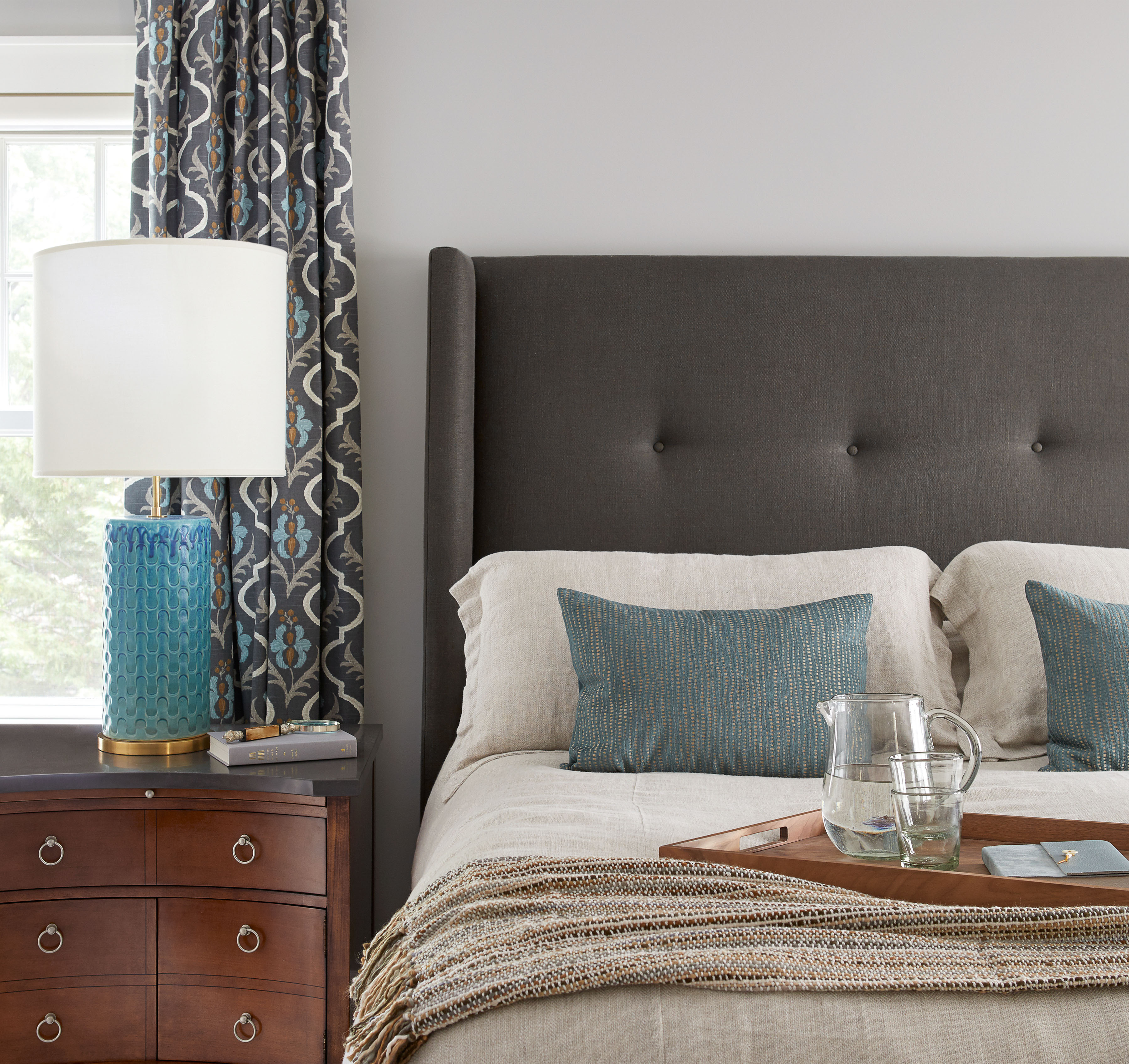 new jersey home tour bedroom with gray tufted headboard