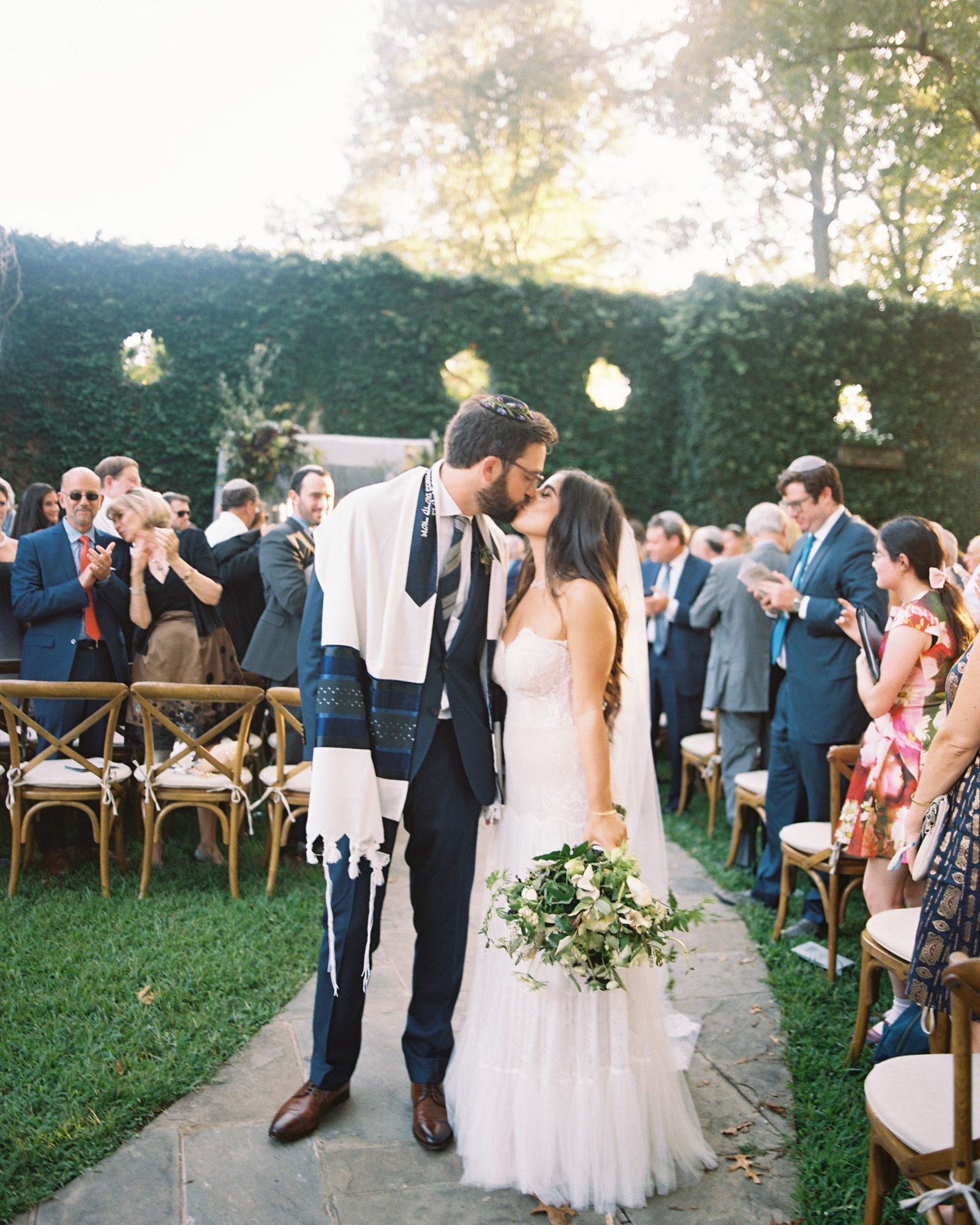 outdoor wedding recessional couple kiss