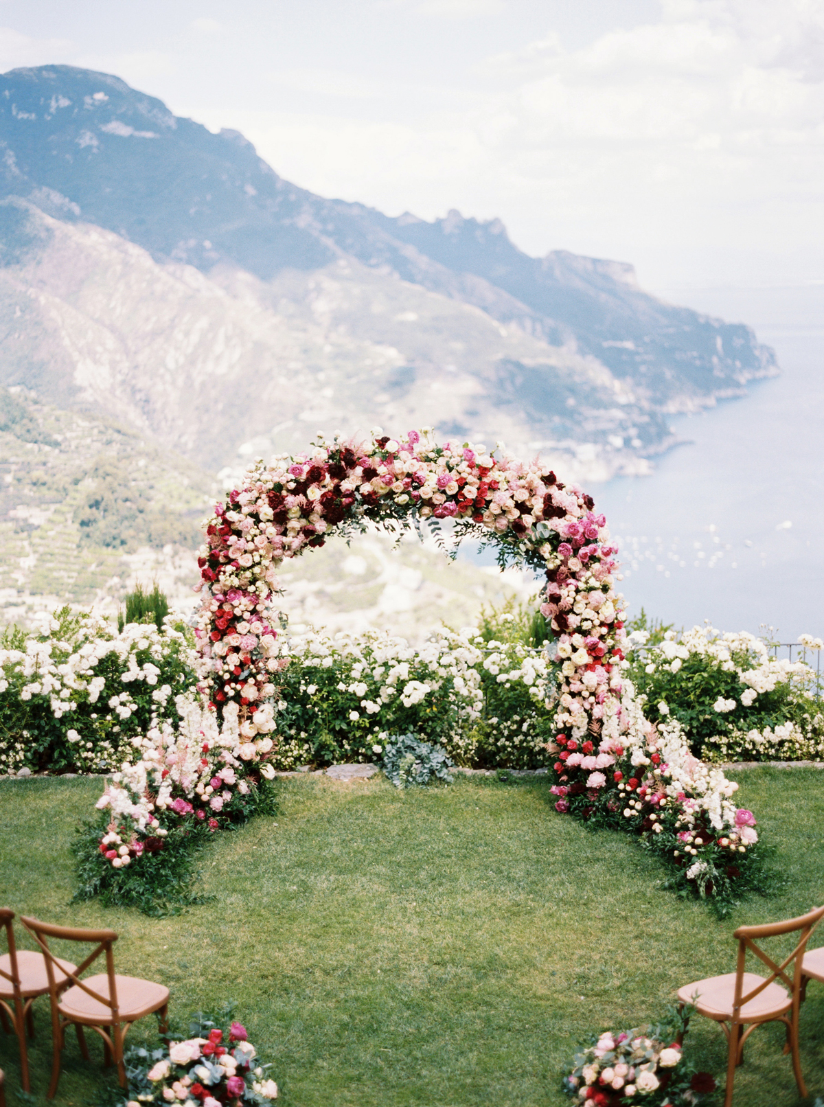 allie and joe italy wedding floral arch overlooking amalfi coast