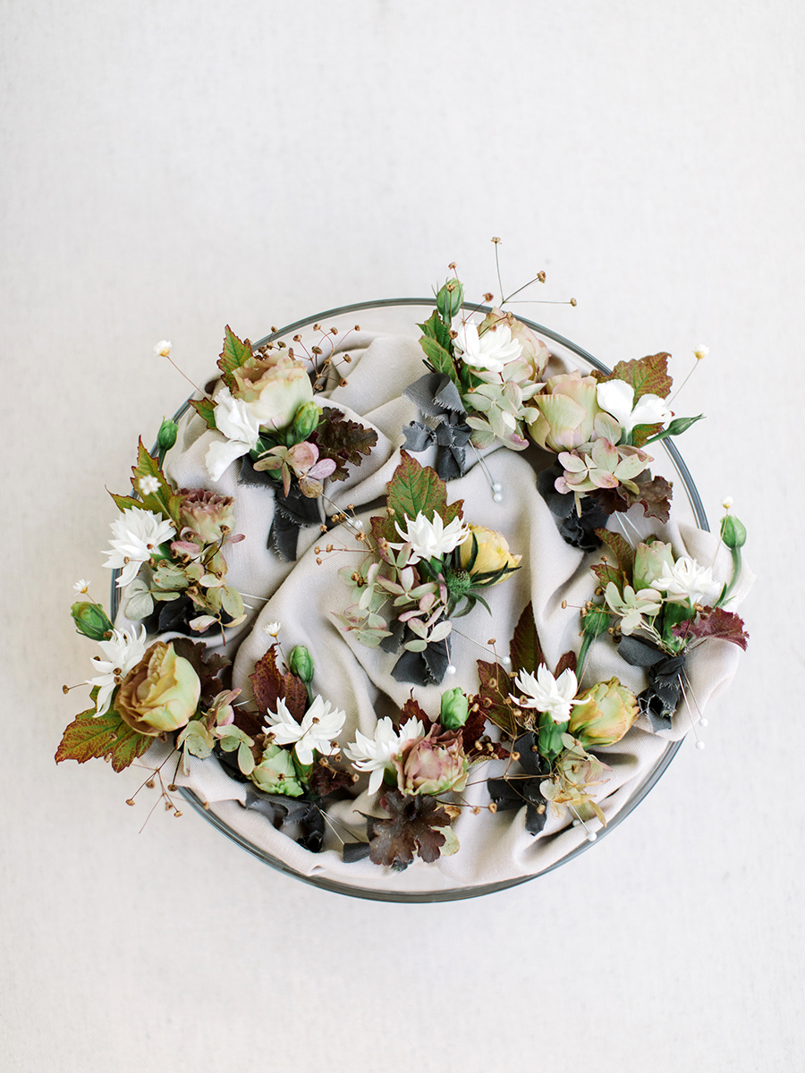 muted colored leaves and blooms boutonnieres