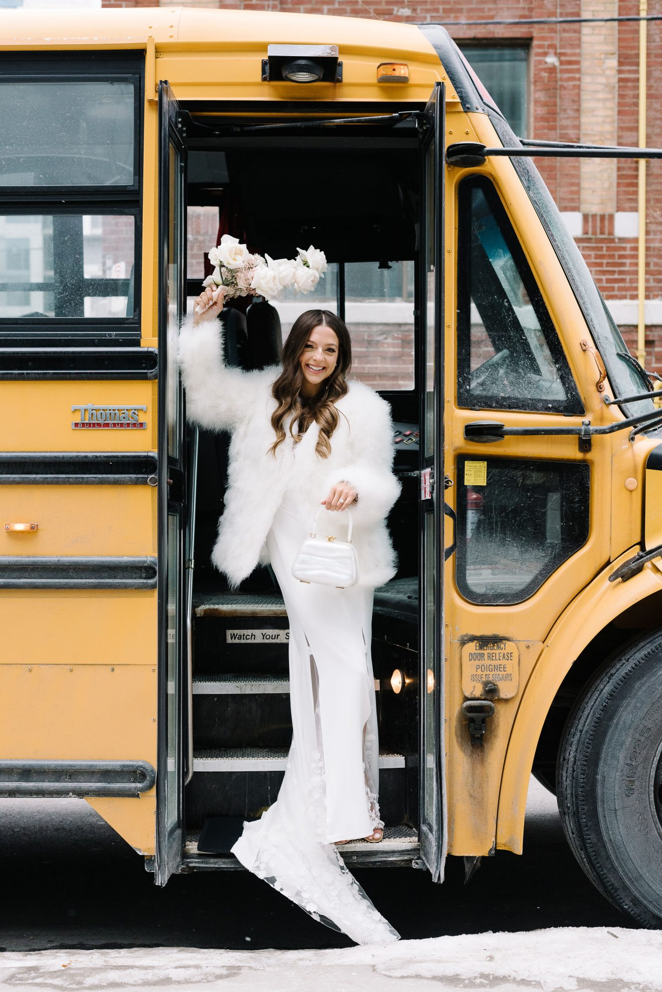 krista will wedding bride posing in school bus entrance