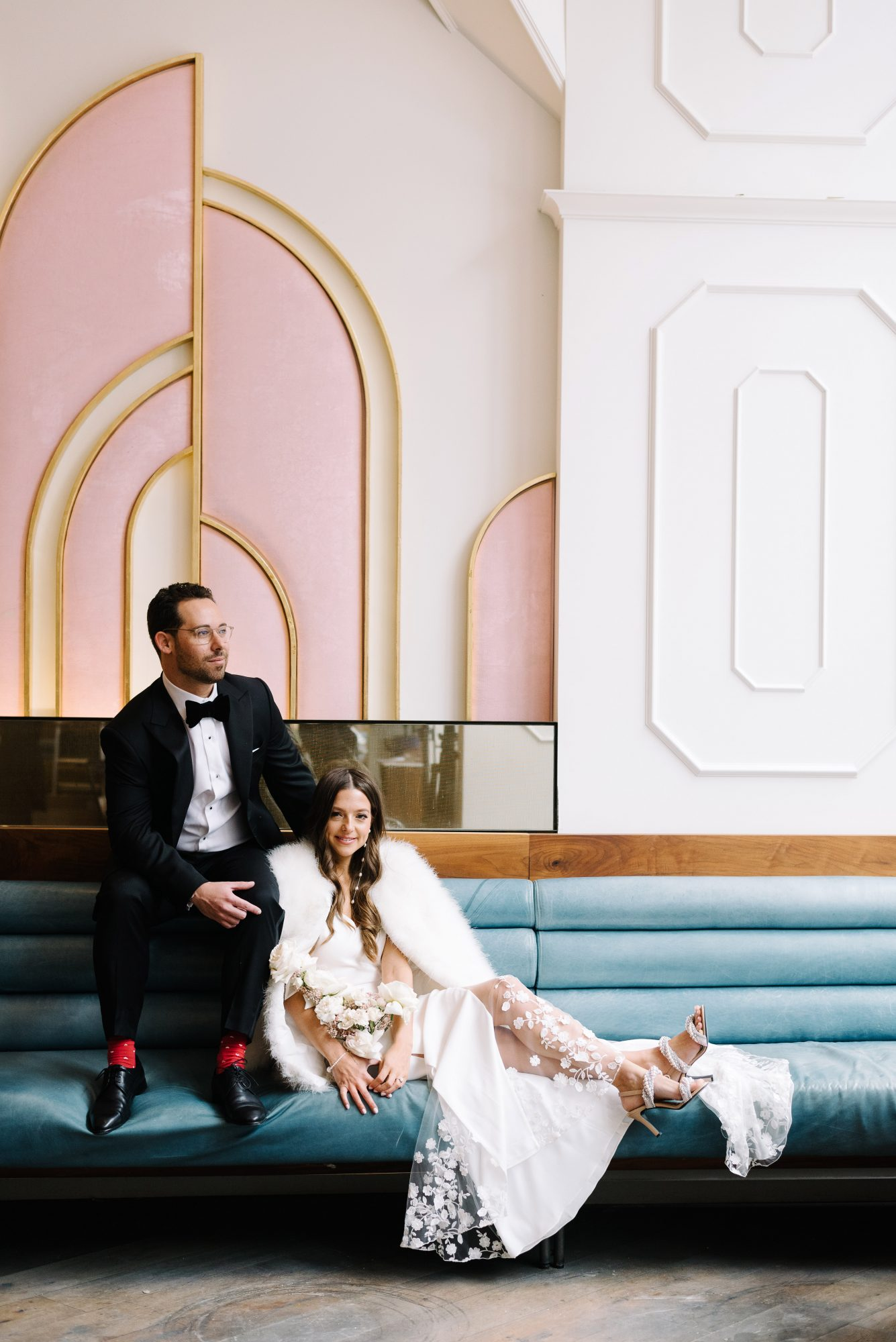 krista will wedding couple posing on built in sofa art deco design