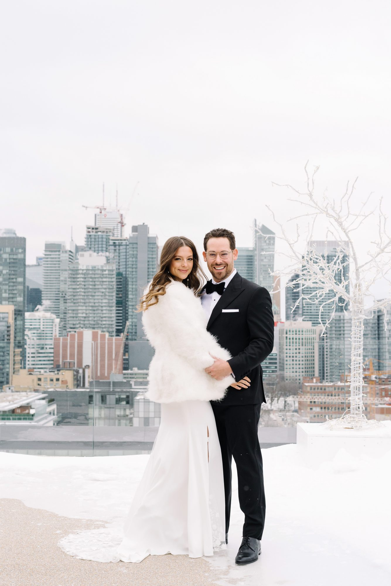 krista will wedding couple outside fur coat cityscape