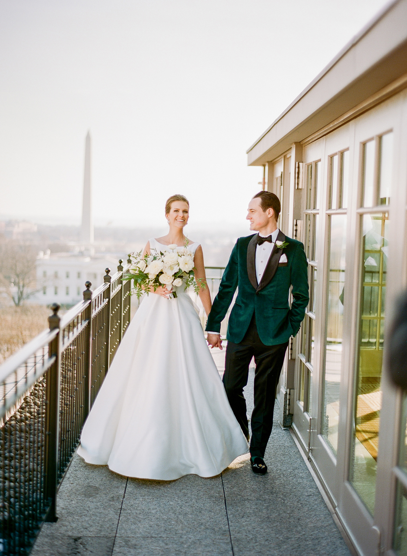 bride and groom outside holding hands