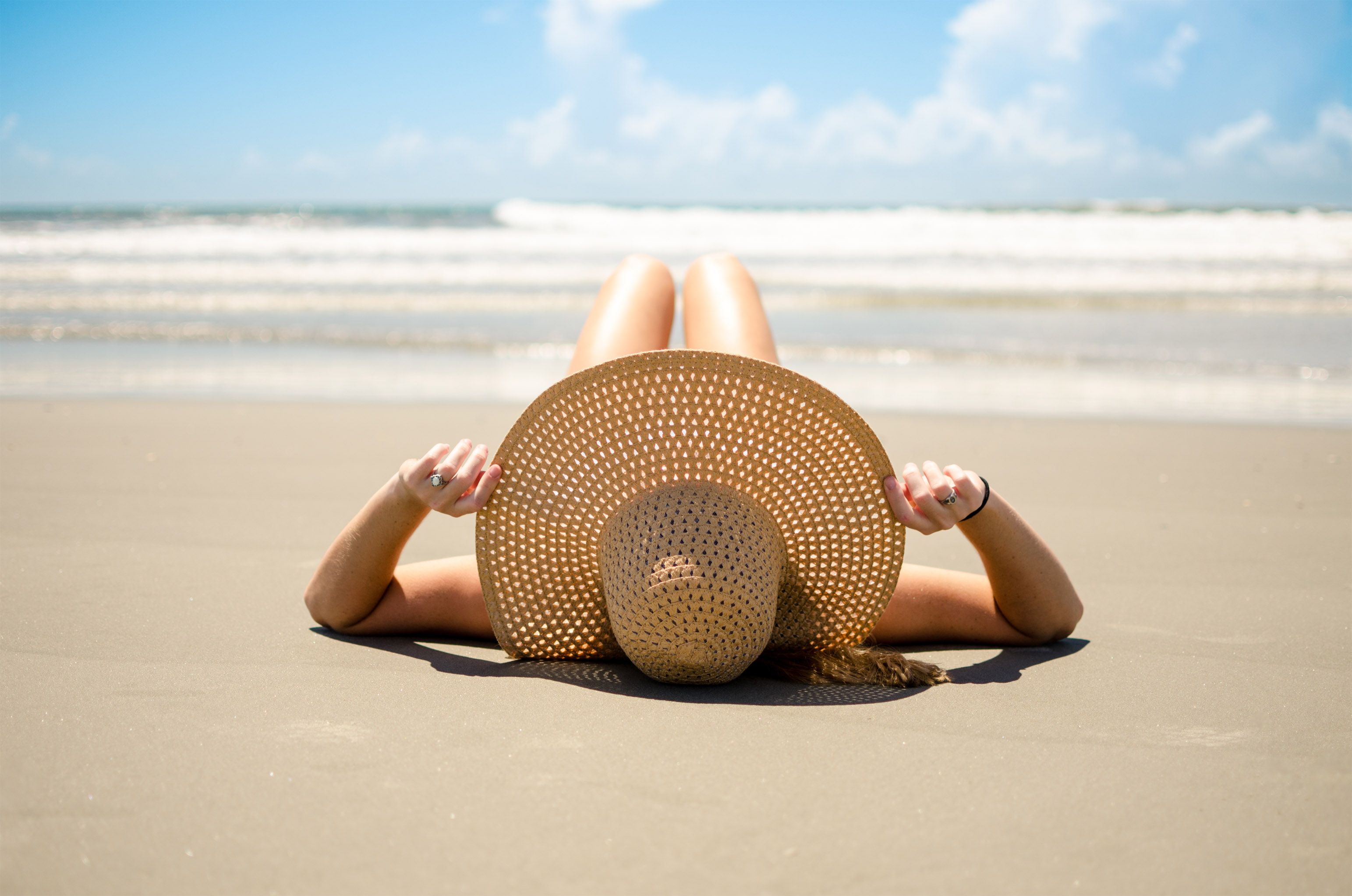 Woman-laying-on-beach