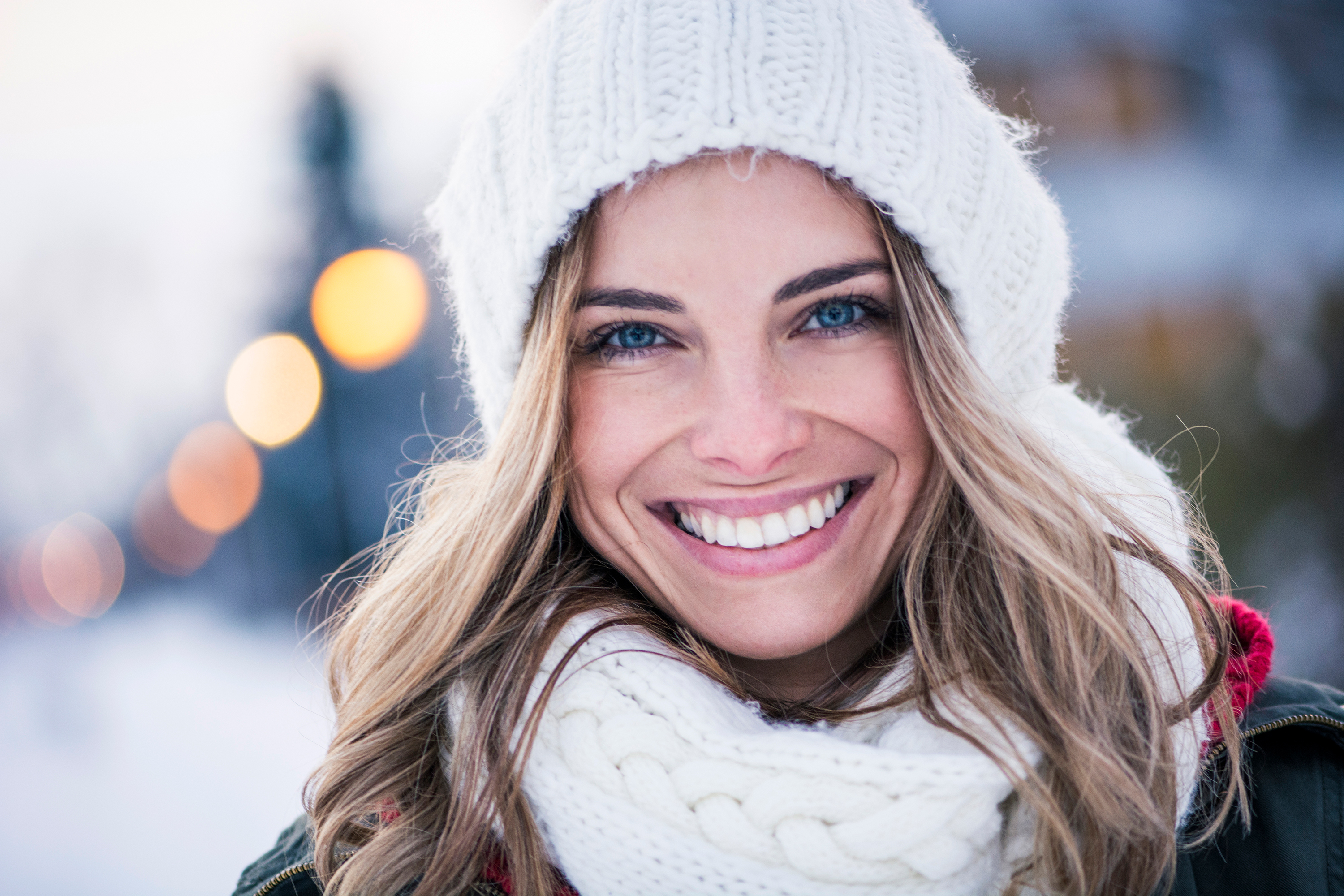 Woman Smiling and Standing in the Snow