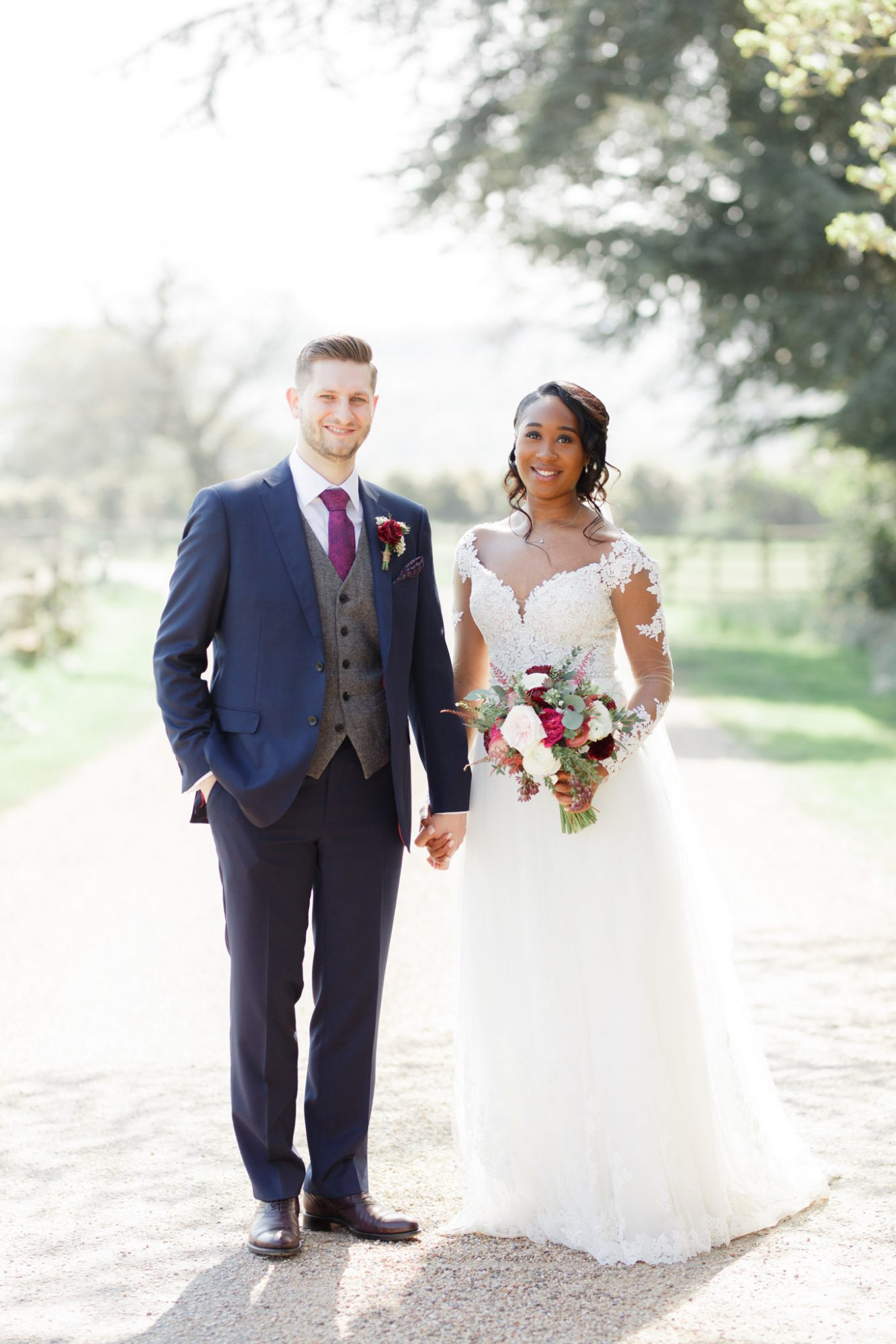ryan thomas wedding couple holding hands in front of trees
