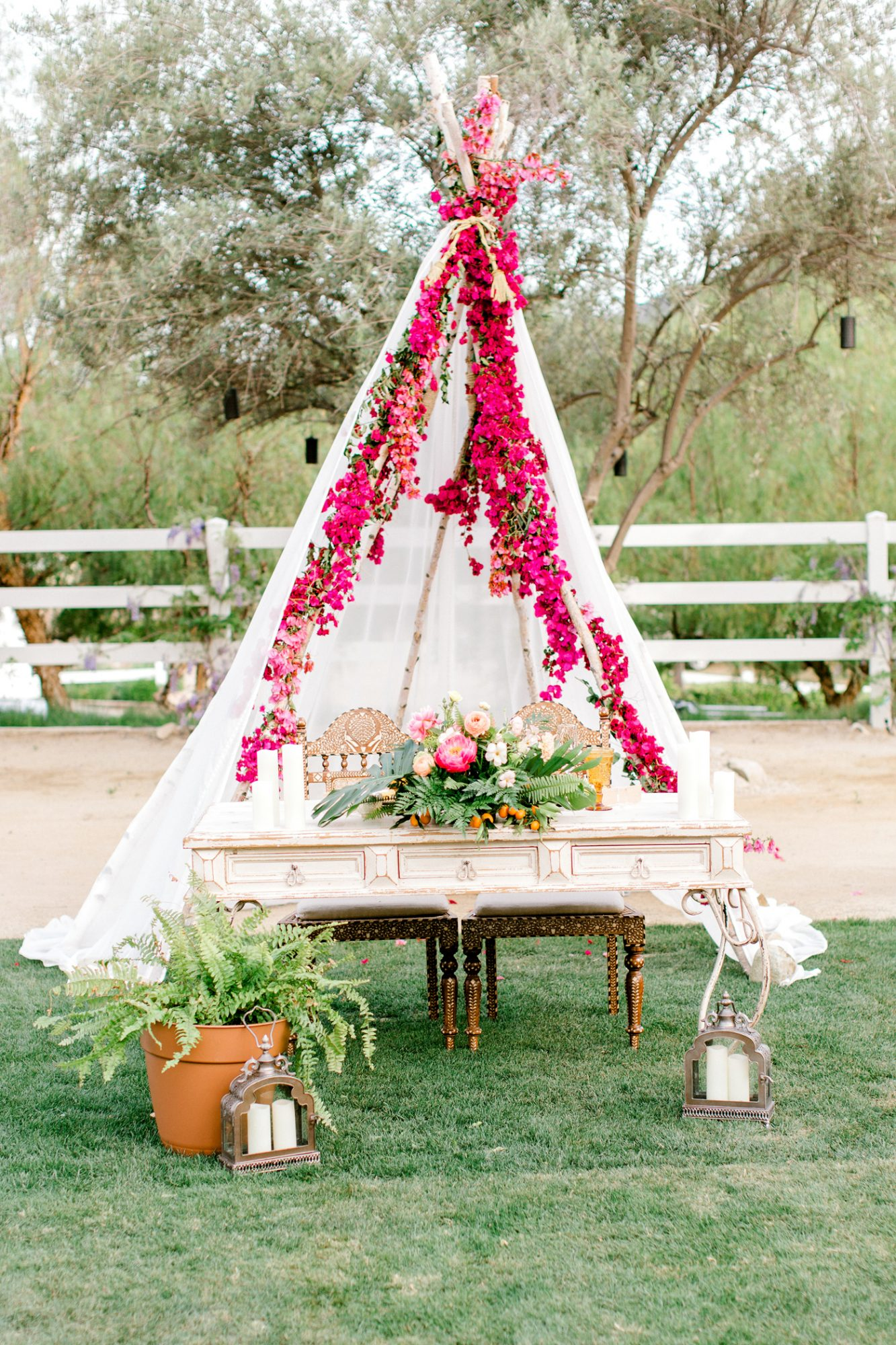 sweetheart table floral teepee with antique display