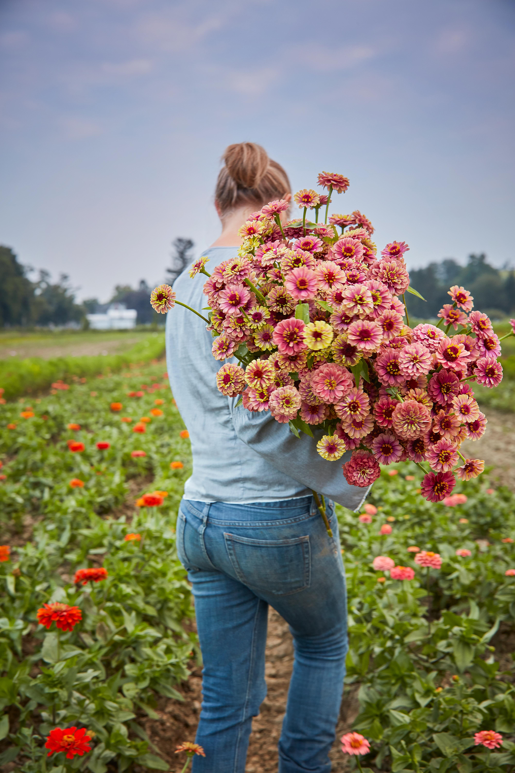 farmer carrying bouquet of flowers