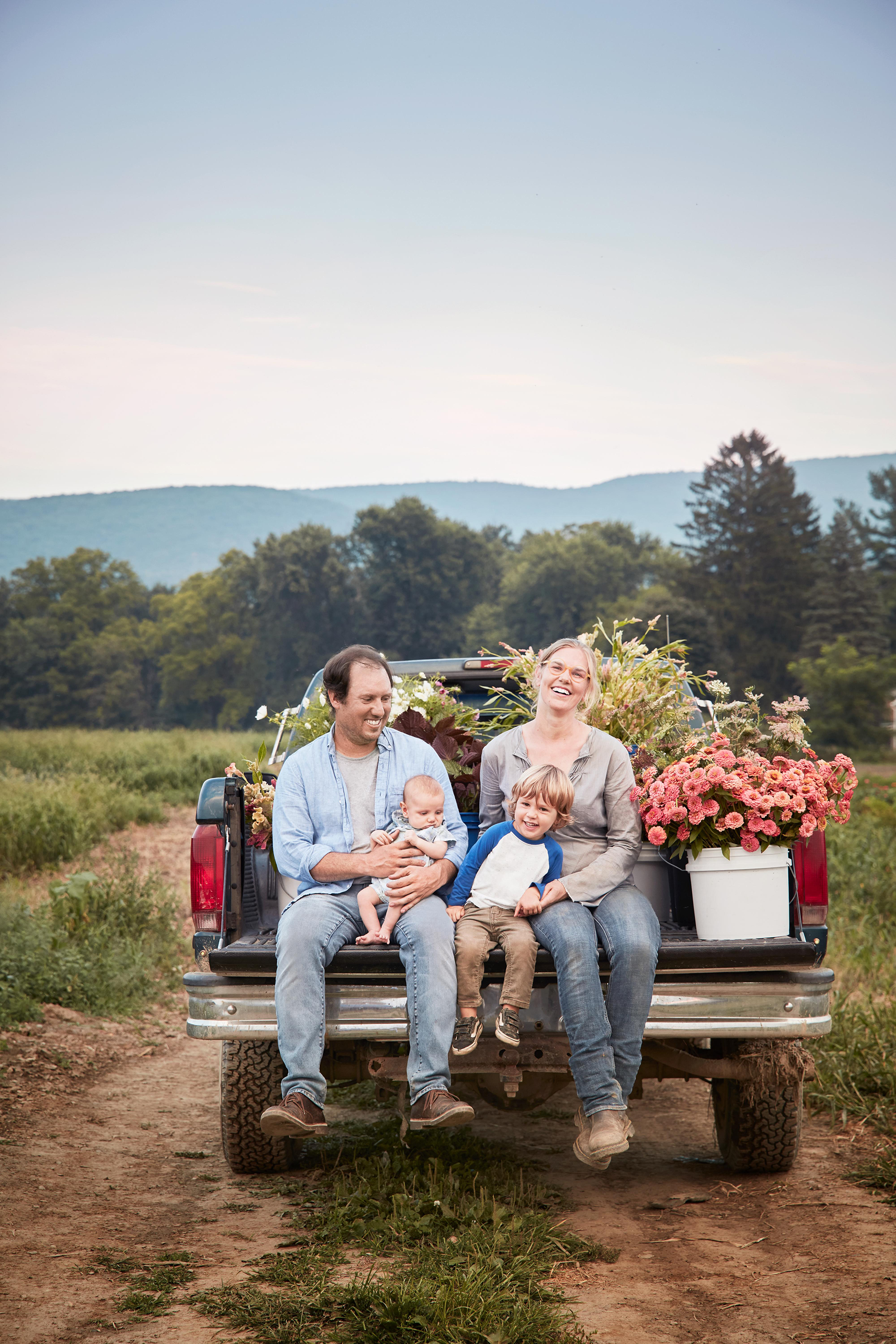 The Tiny Hearts' family in a truck on their farm.