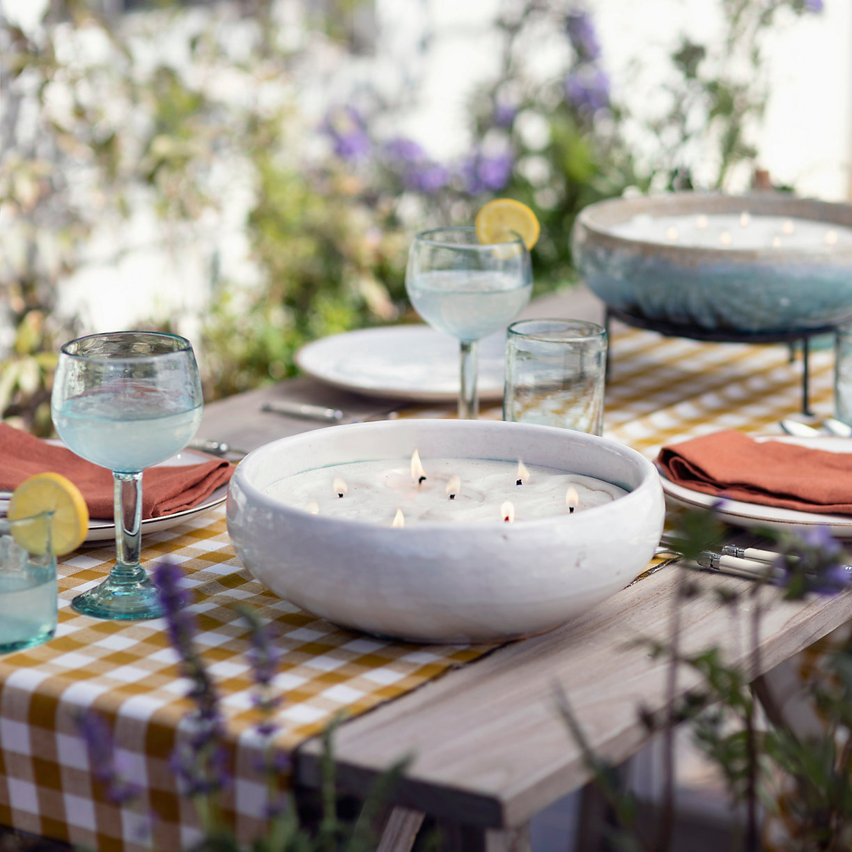 outdoor table setting with citronella candle