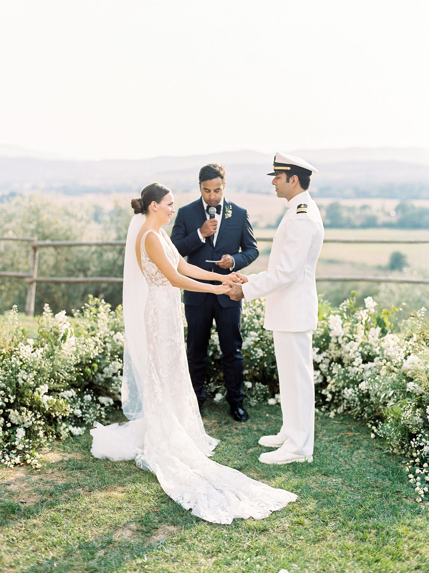 kseniya sadhir wedding outdoor ceremony couple and officiant