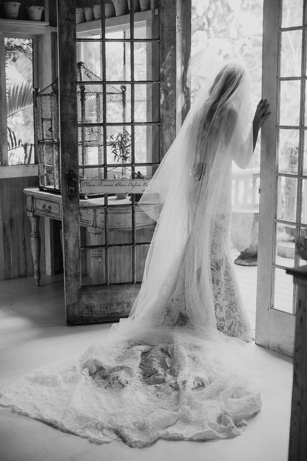 sarah daniel wedding bride looking out french door