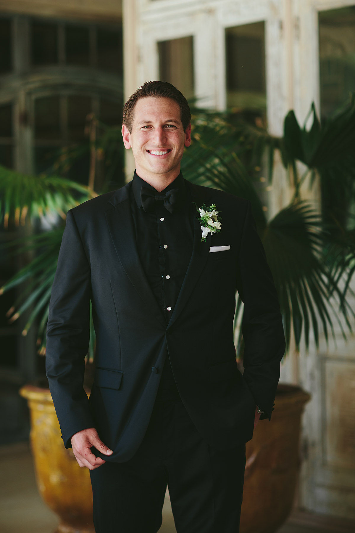 sarah daniel wedding groom in black suit