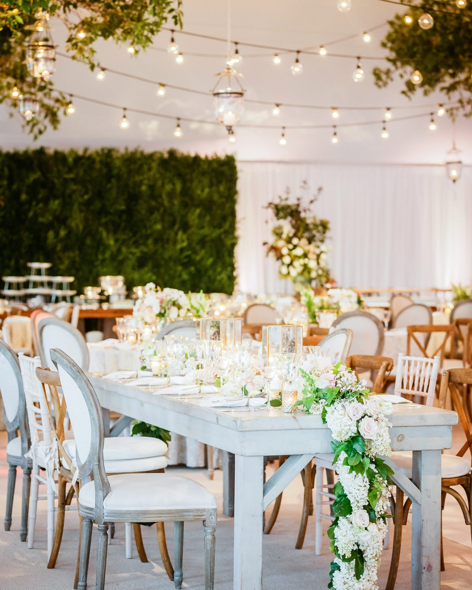 night wedding idea natural elements and string lights in tent