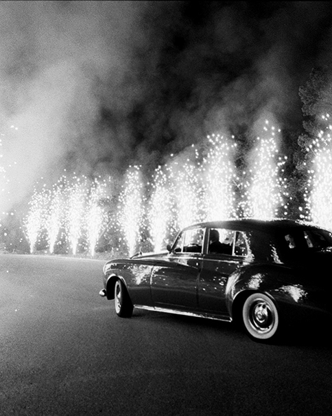 night wedding idea sparklers and a classic car