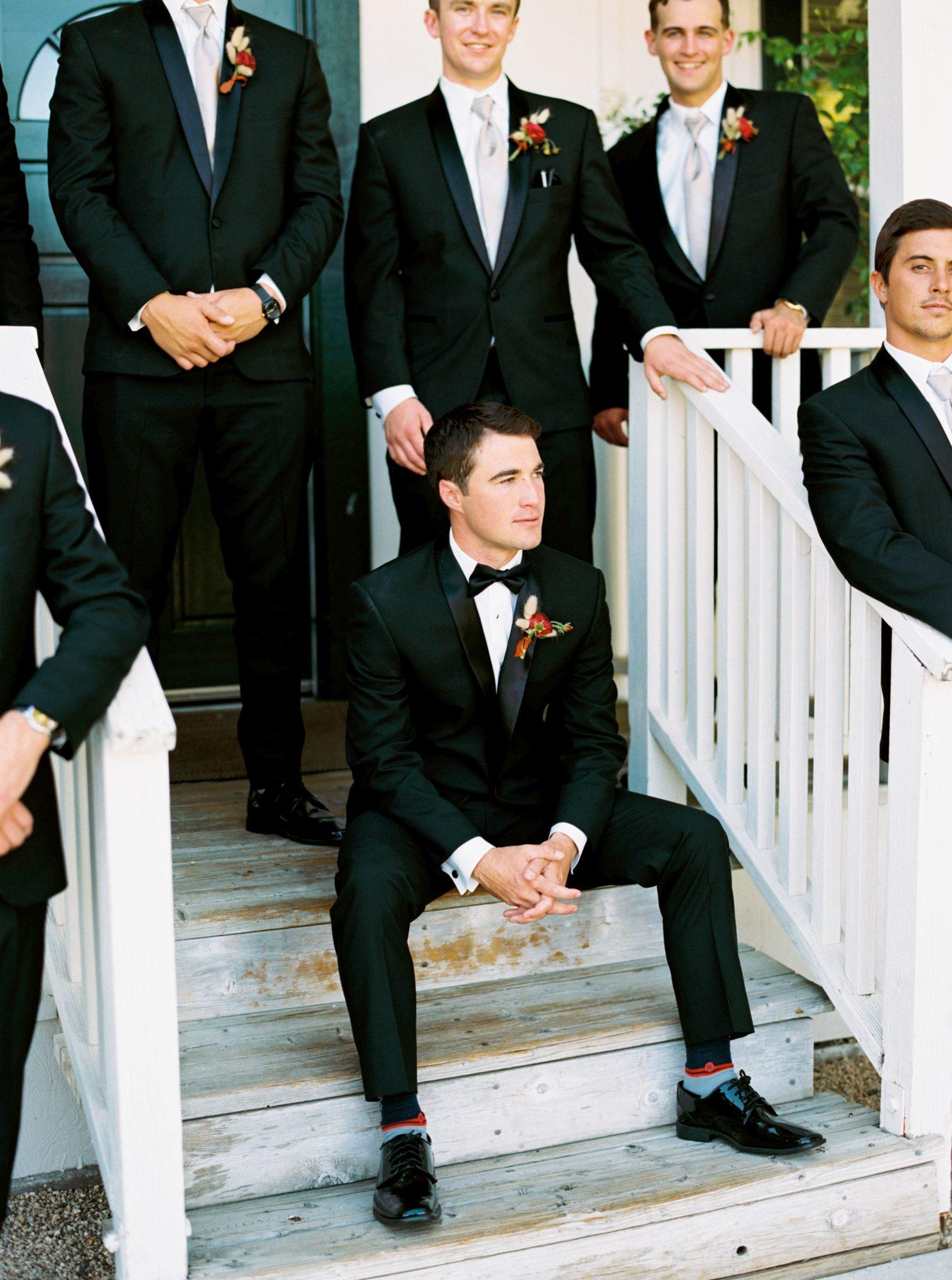 groom and groomsmen waiting on front porch