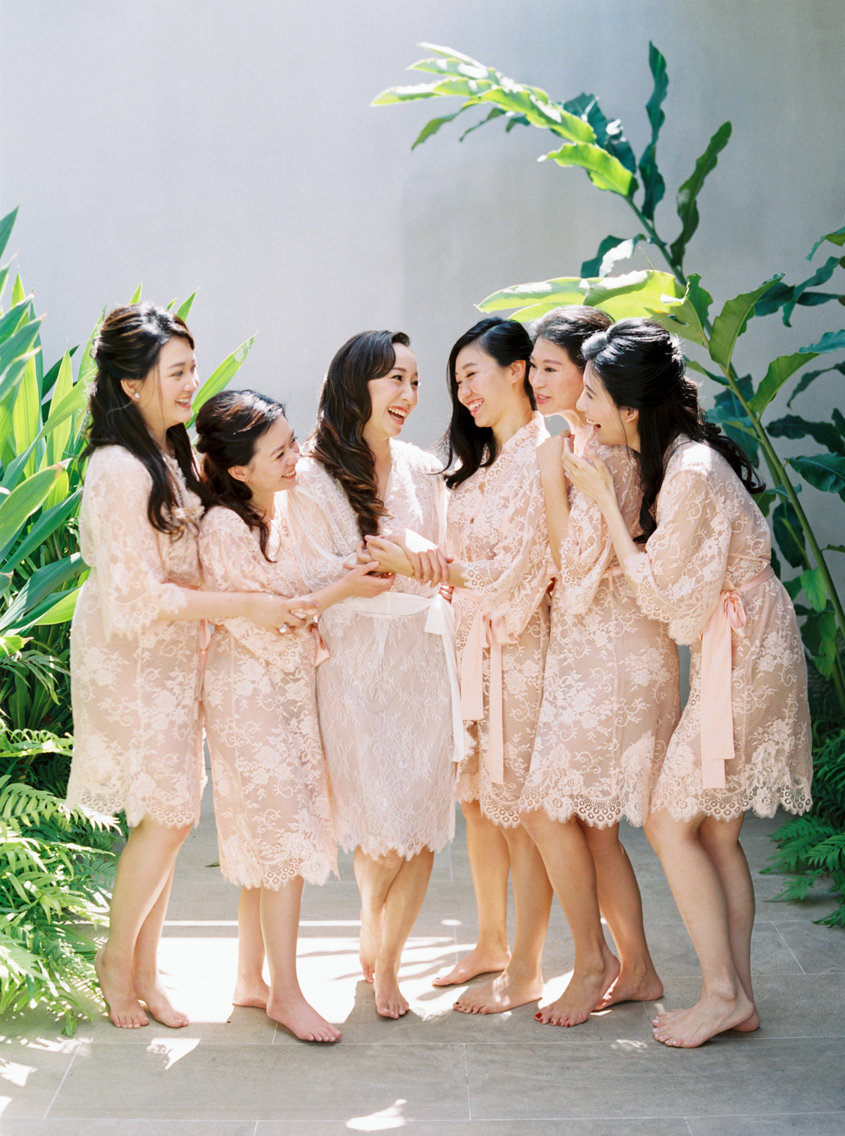bridesmaids and bride wearing lace robes