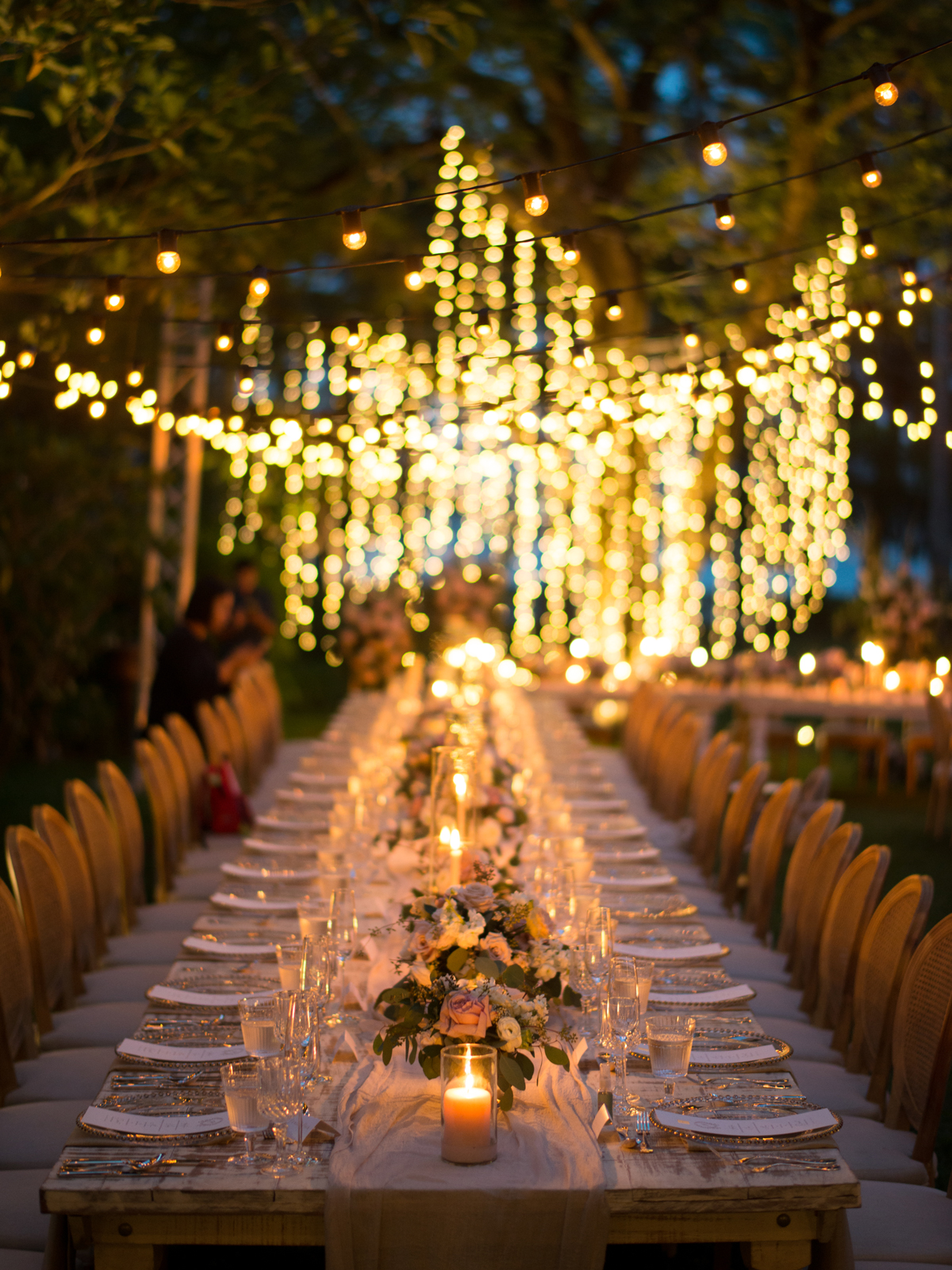 reception tables under dripping lights