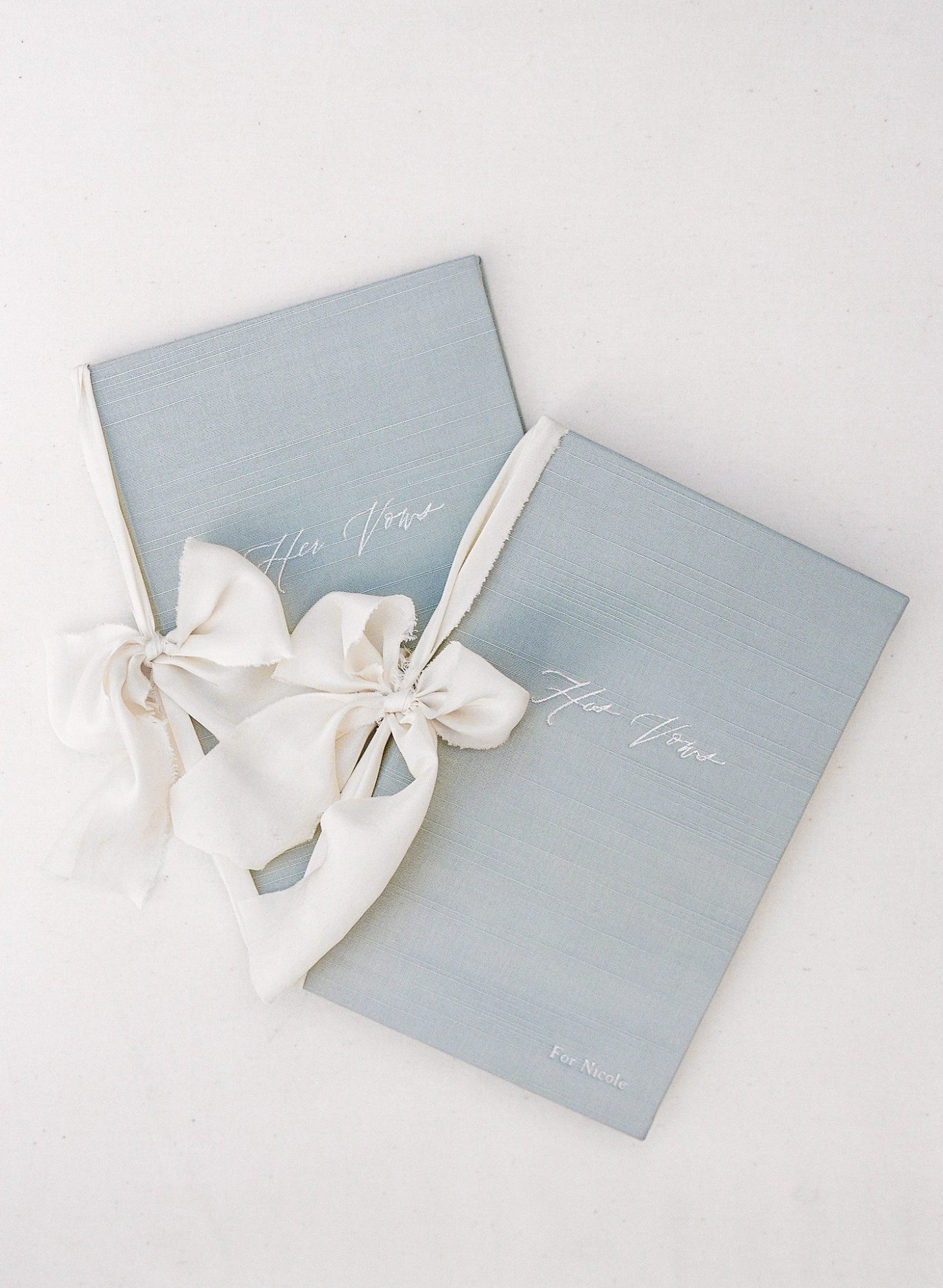 vow books white raw edge bows