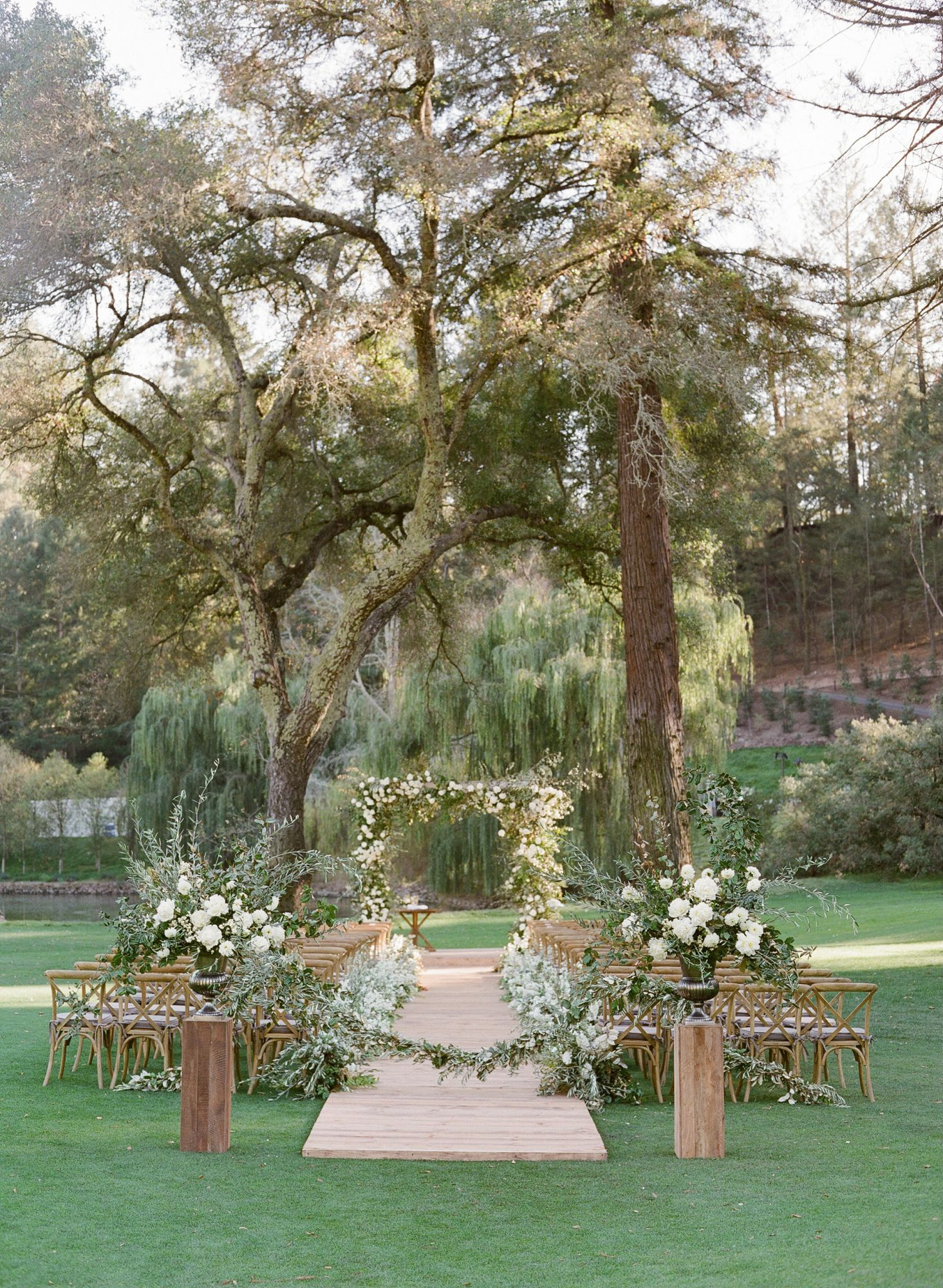 outdoor wedding ceremony golf course wooden chairs