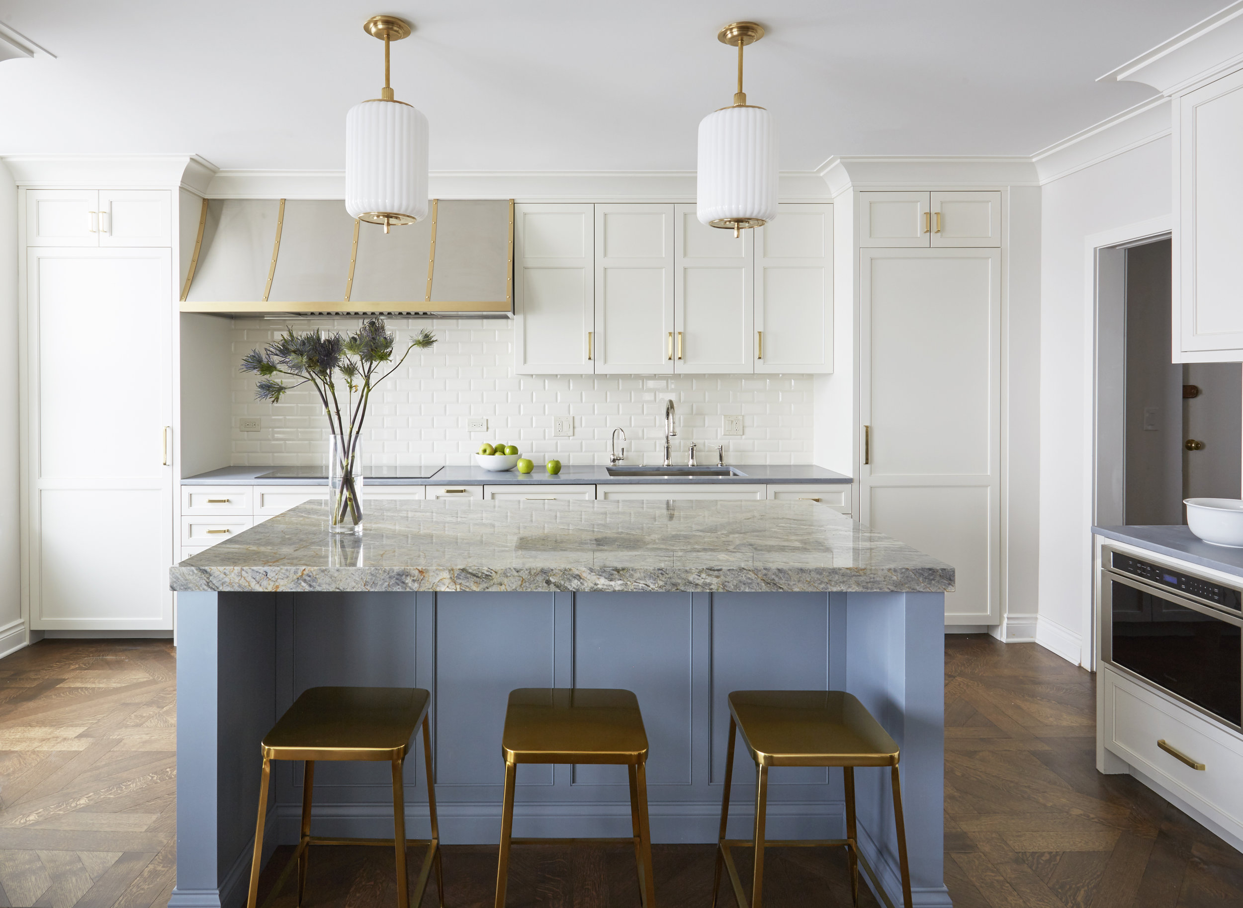 wide shot of blue and white modern, airy kitchen