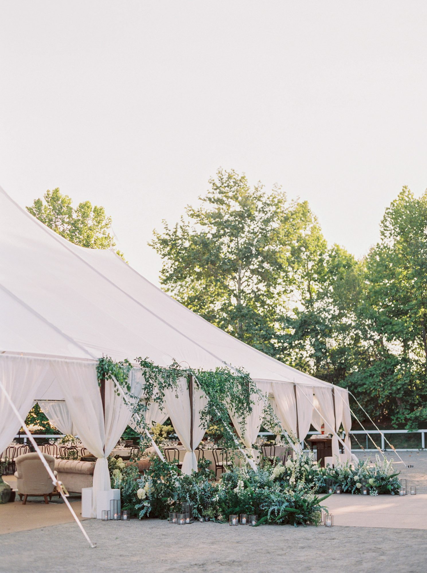 katie mike wedding tent with lush greenery
