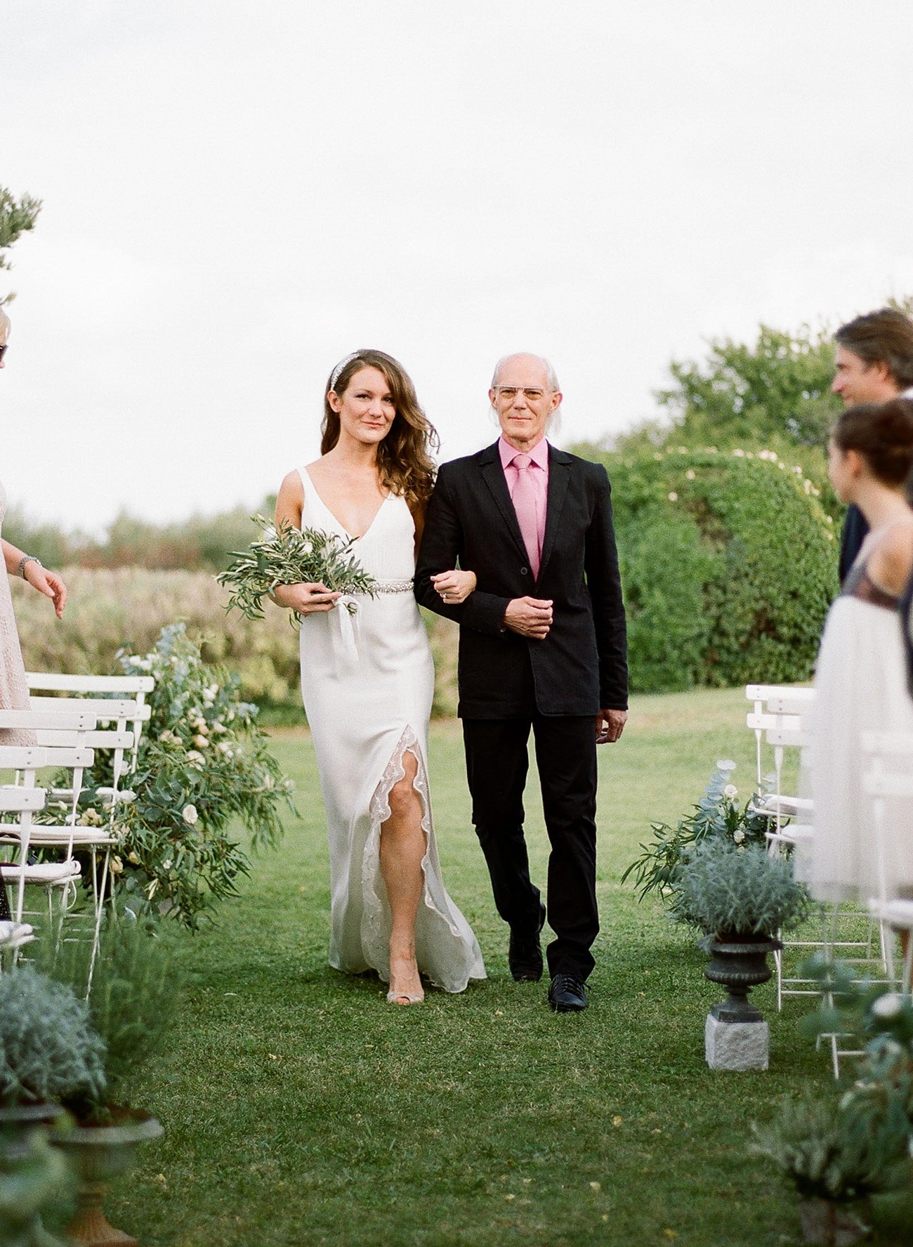 father of the bride wearing black suit with pink shirt and tie combo