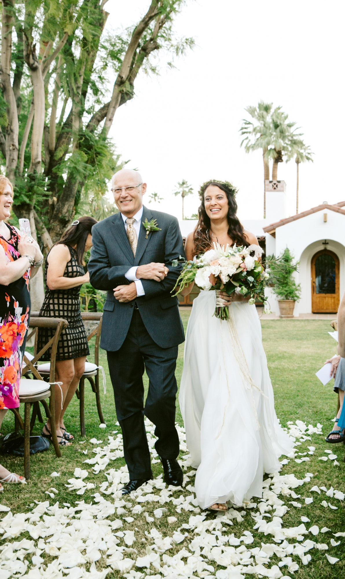 father of the bride wearing a black suit with gold tie