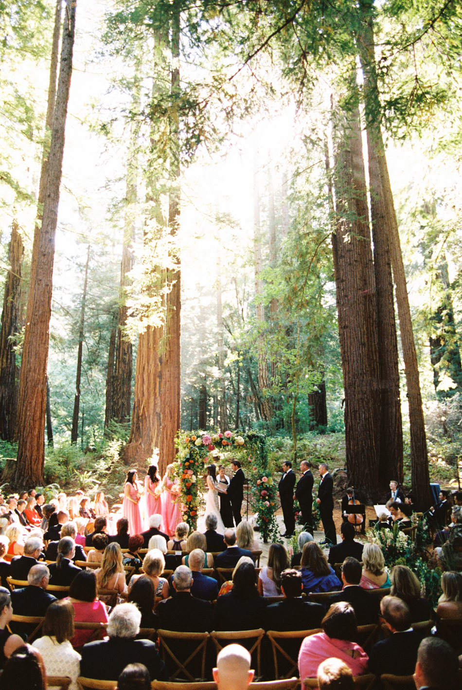 bride and groom during outdoor forest wedding ceremony