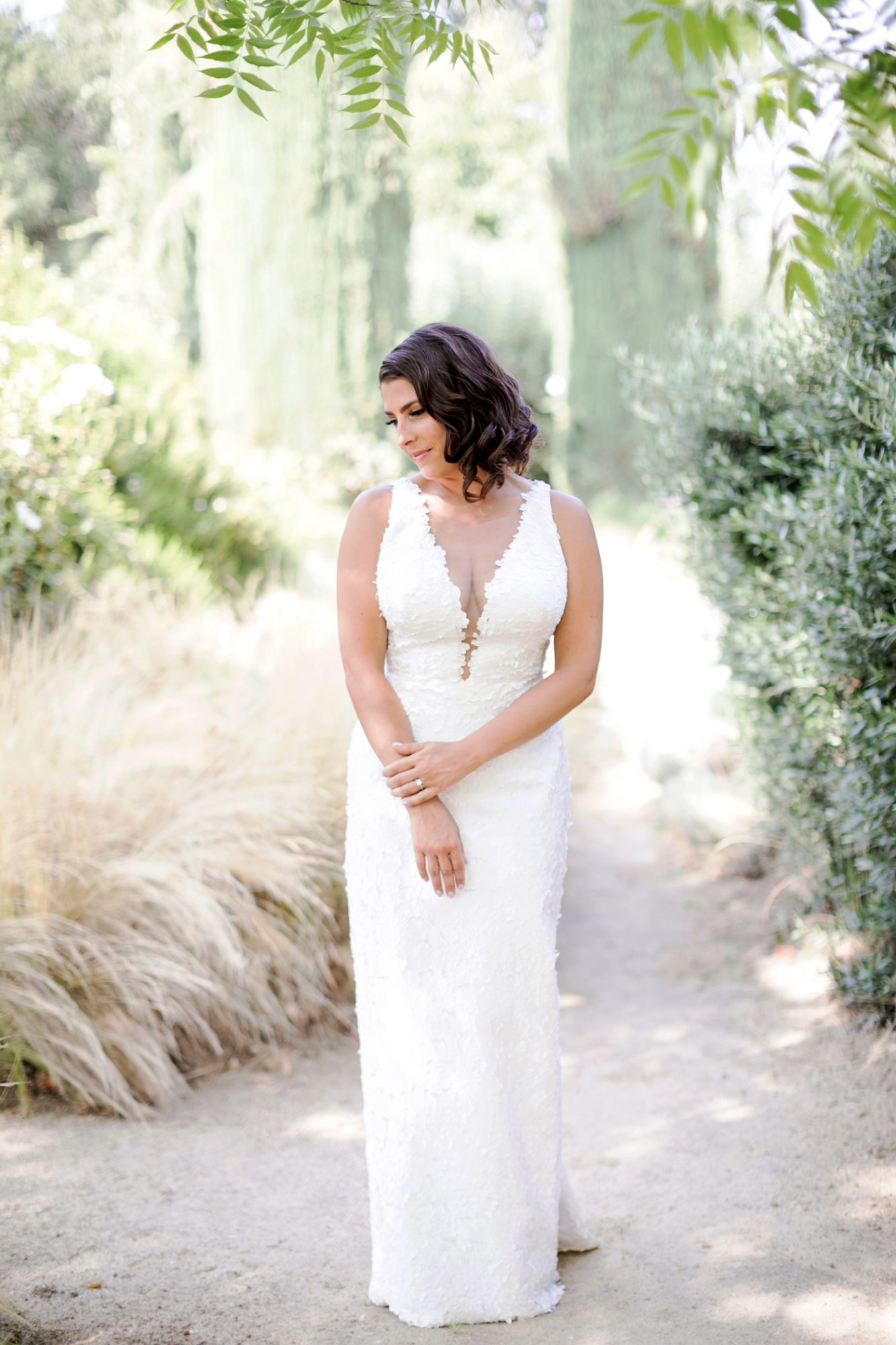 bride wearing Romona Keveza sleeveless illusion deep v-neck wedding dress