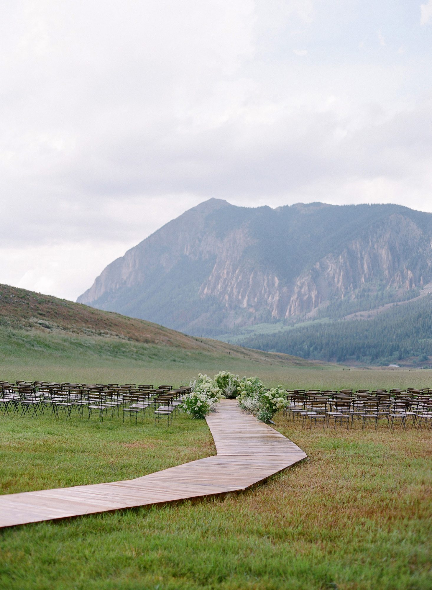 sloan scott wedding ceremony boardwalk chairs and mountains