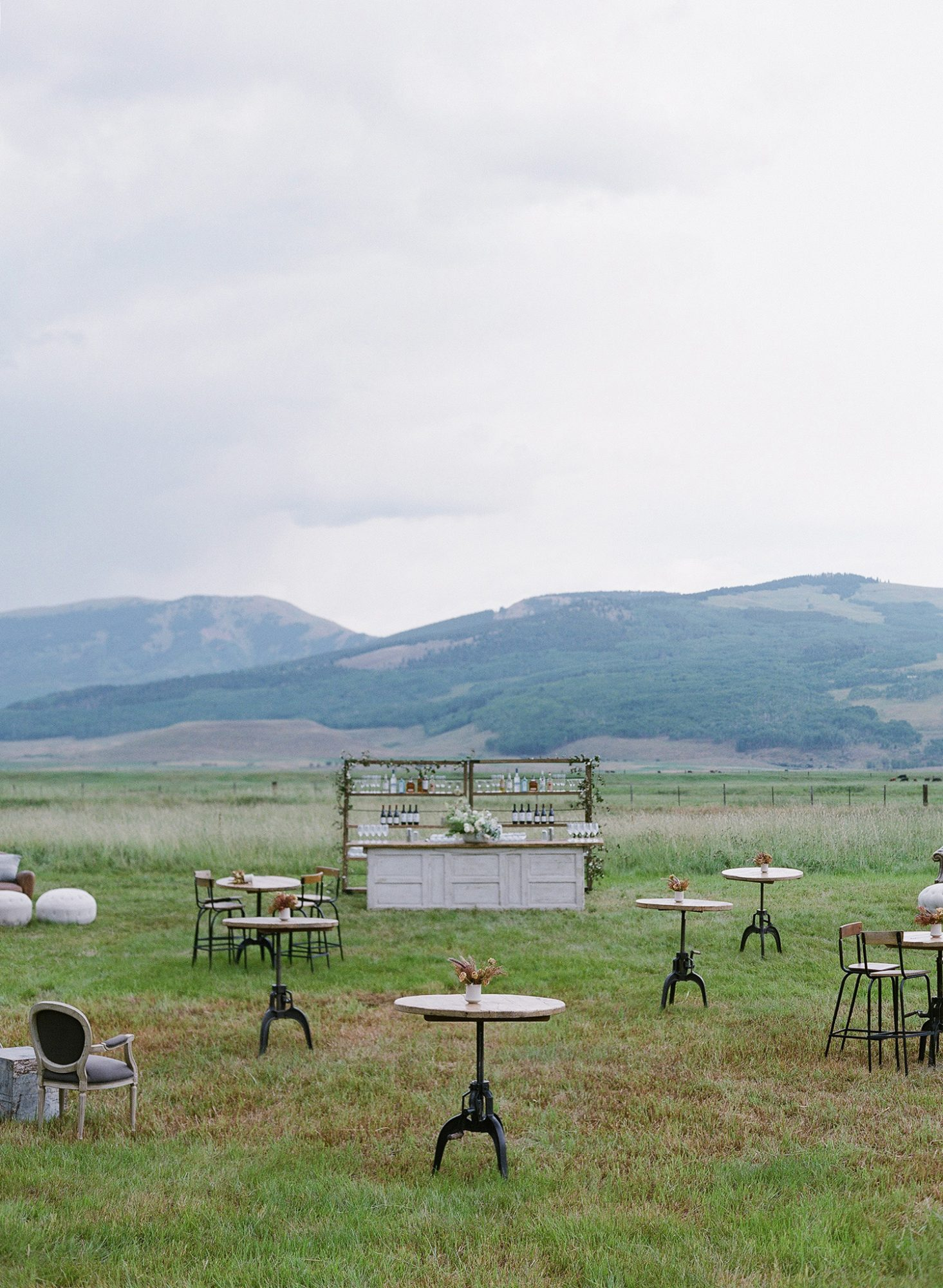 sloan scott wedding cocktail hour on lawn against mountains