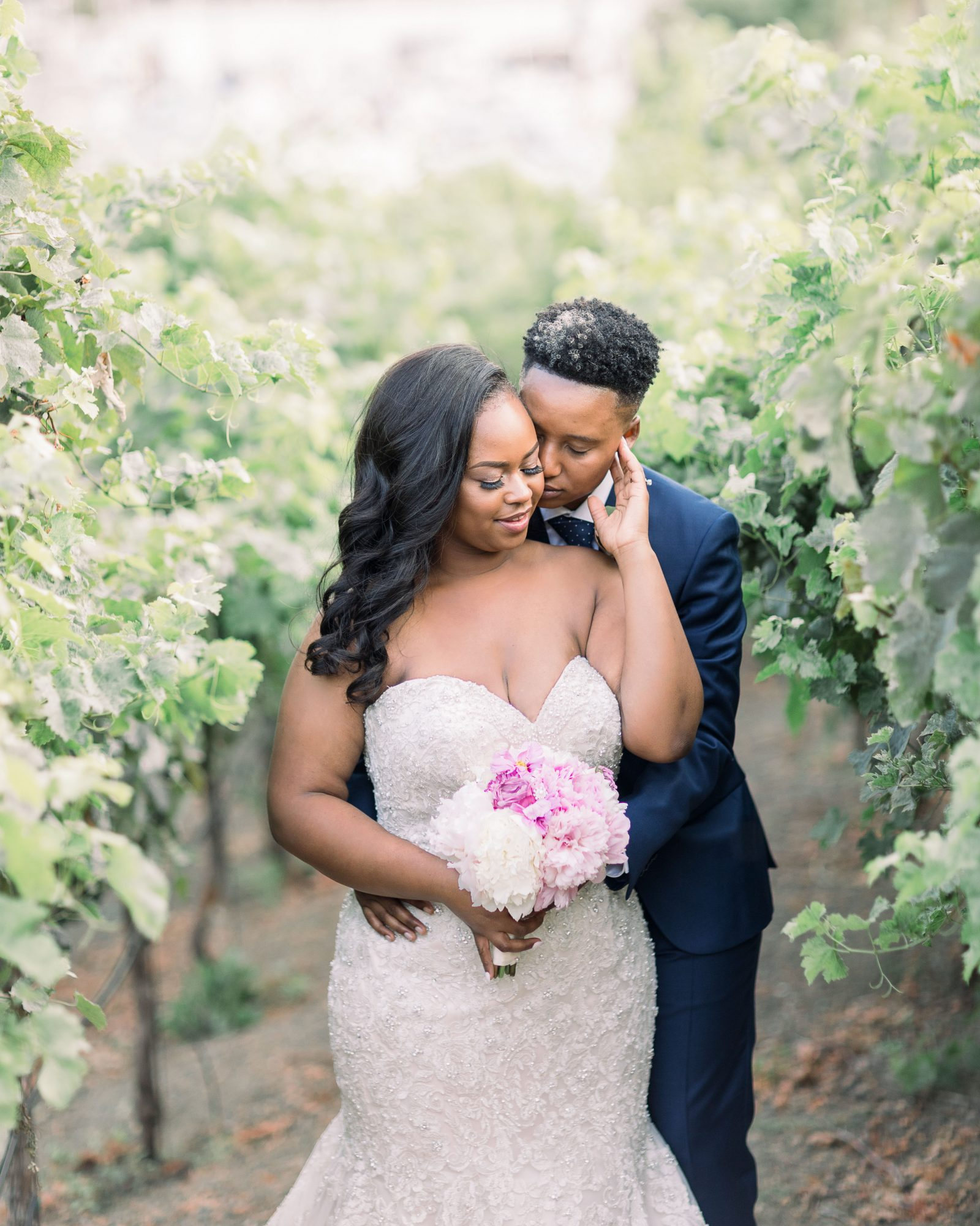 wedding couple pose outdoors in field