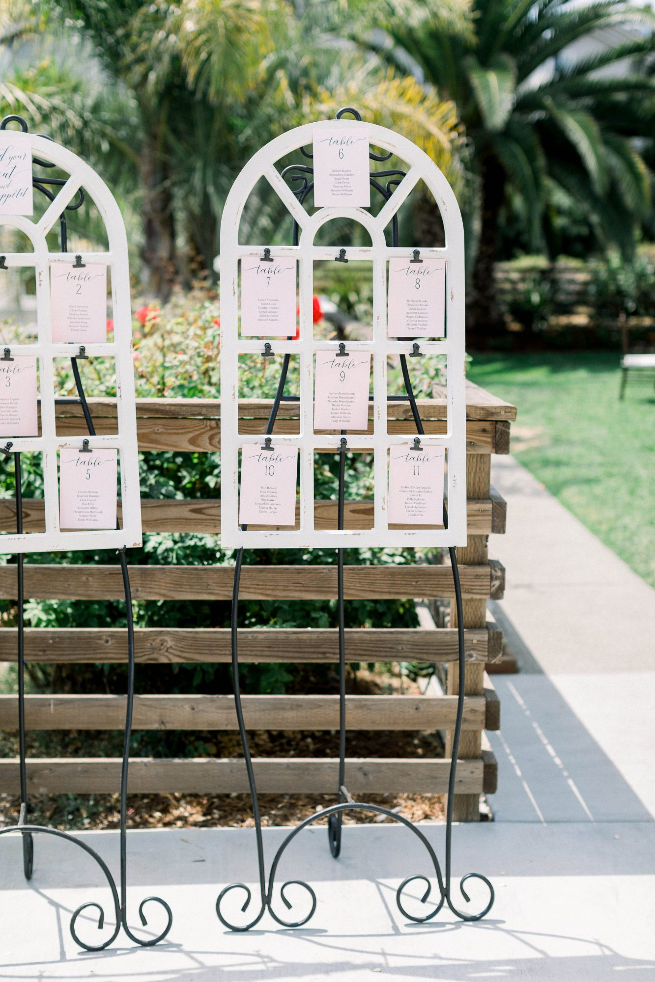 blush colored escort cards wooden easel display