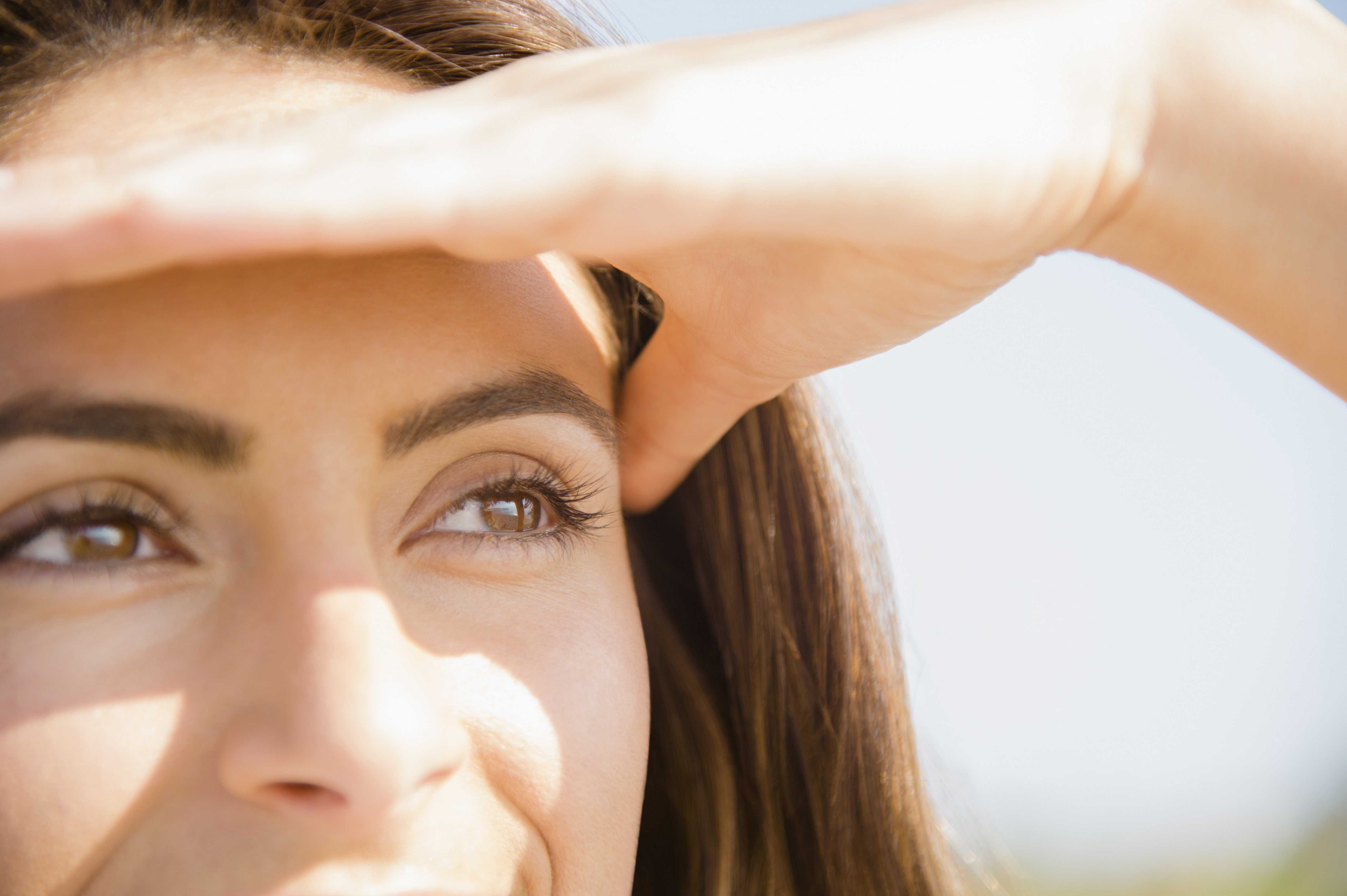 woman shielding her eyes from the sun