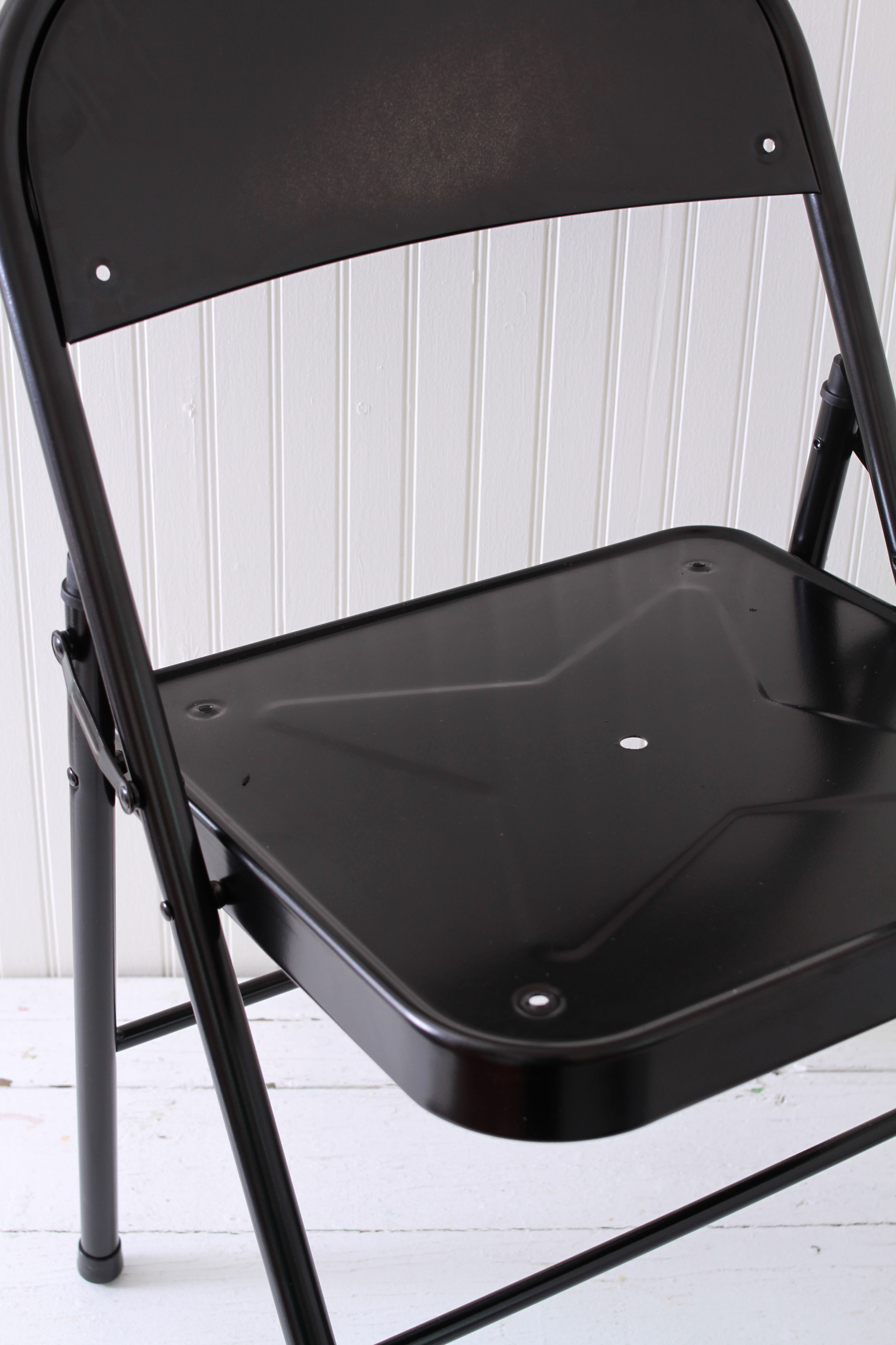 unscrewing the seat pads and backing on a folding chair