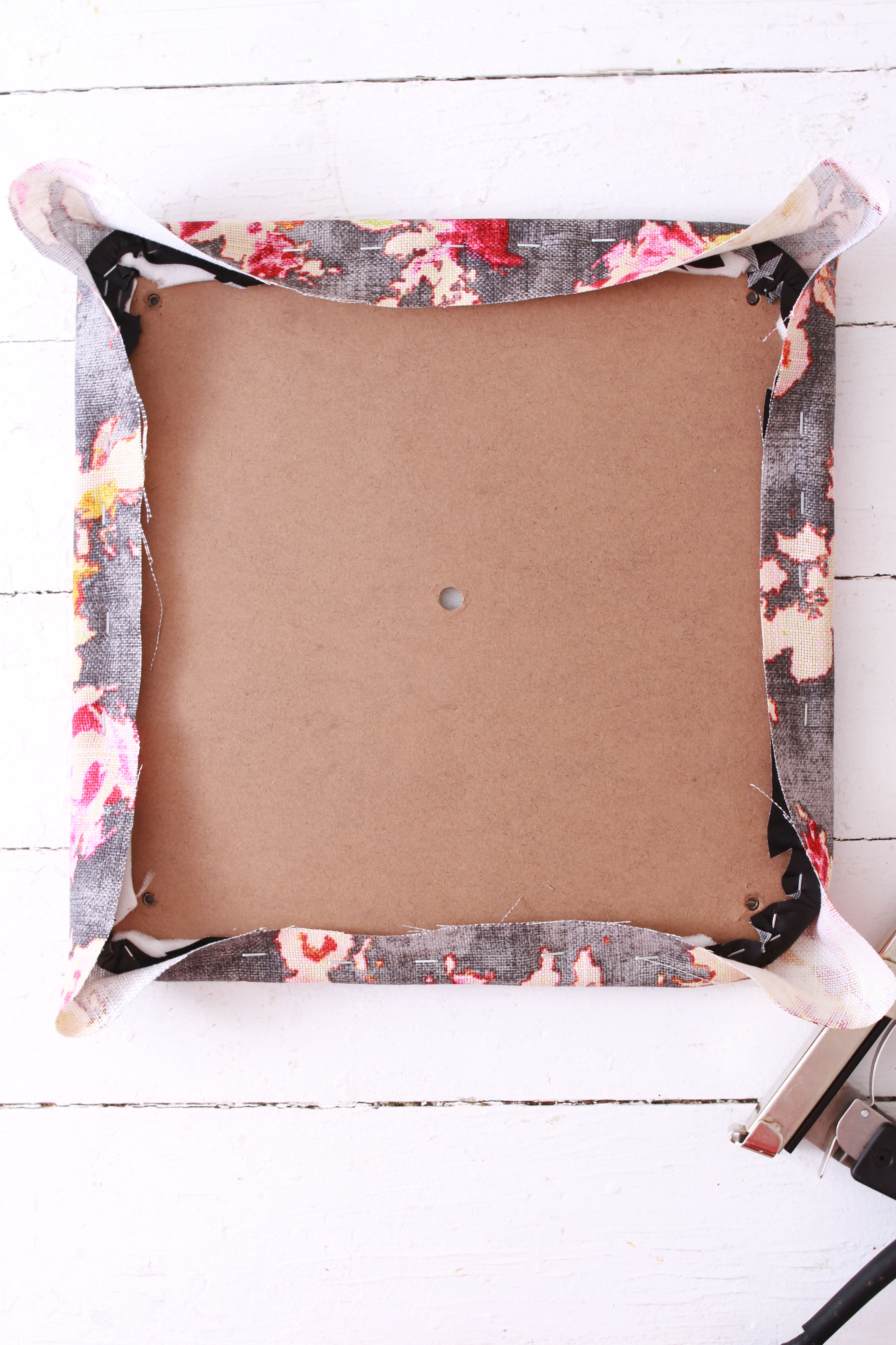 folding chair being reupholstered