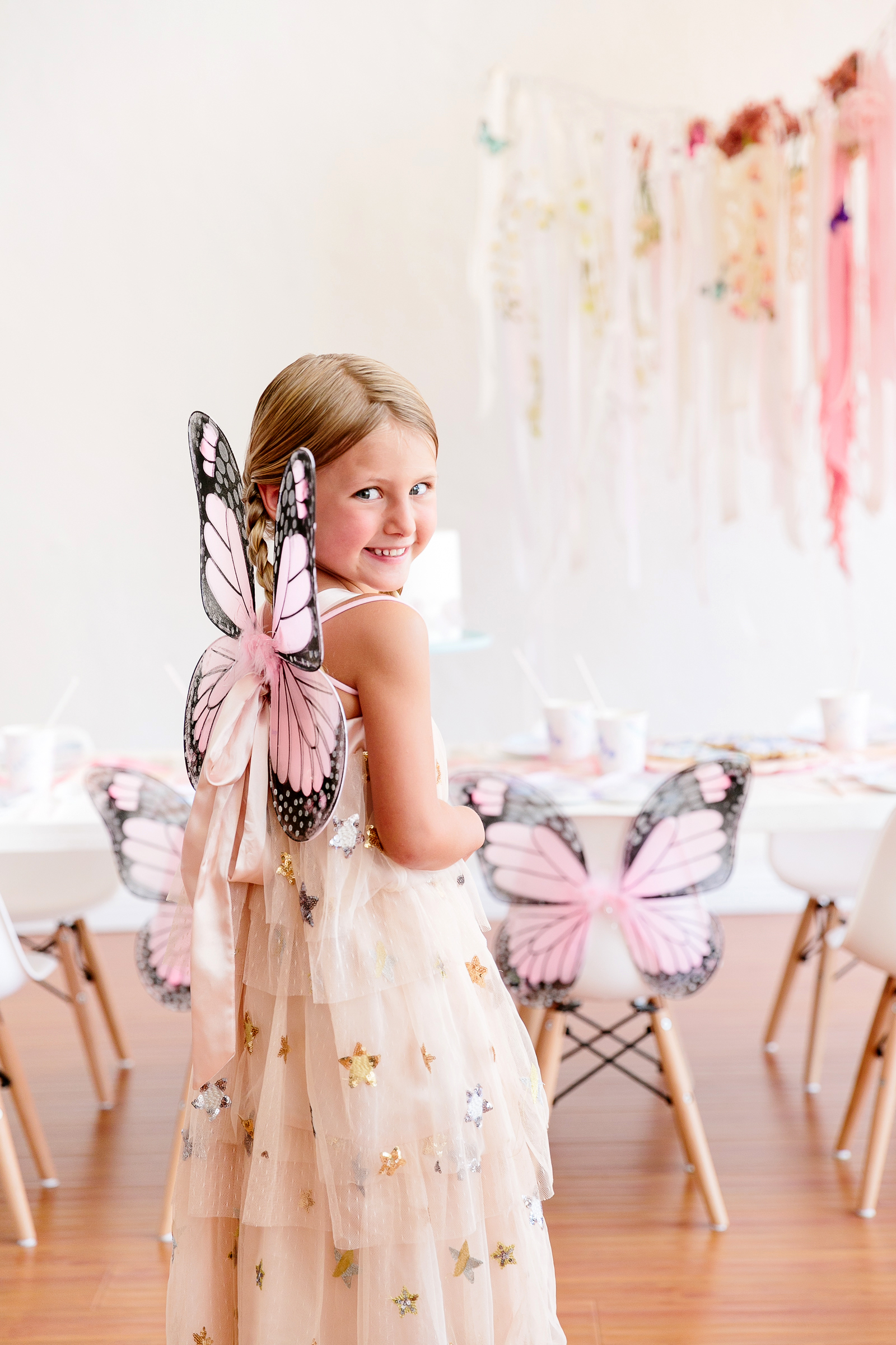 butterfly party little girl wearing butterfly wings