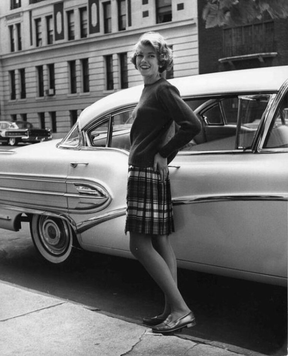 martha standing in front of car during college days