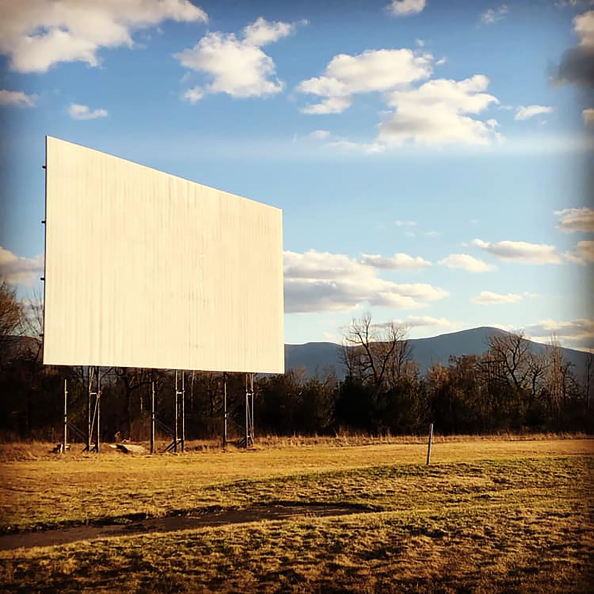 """Nestled in the valleys of upstate New York, just about three hours away from Manhattan, the Greenville Drive-In (also known as Drive-In 32) originally opened in 1959. Today, the theater is known for their snack """"shack,"""" which sells farm-to-table foods and meals alongside a beer garden stocked with local brews. Sometimes, the theater also hires live bands to perform music alongside classic black and white films."""