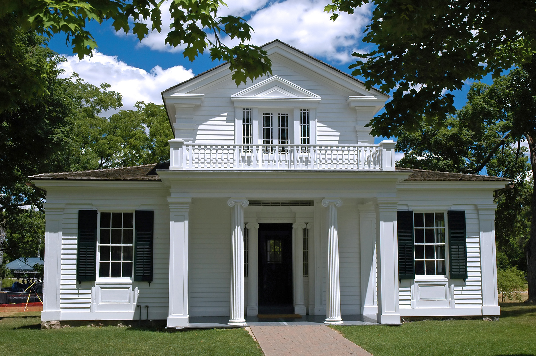 greek revival style home white pillars and columns