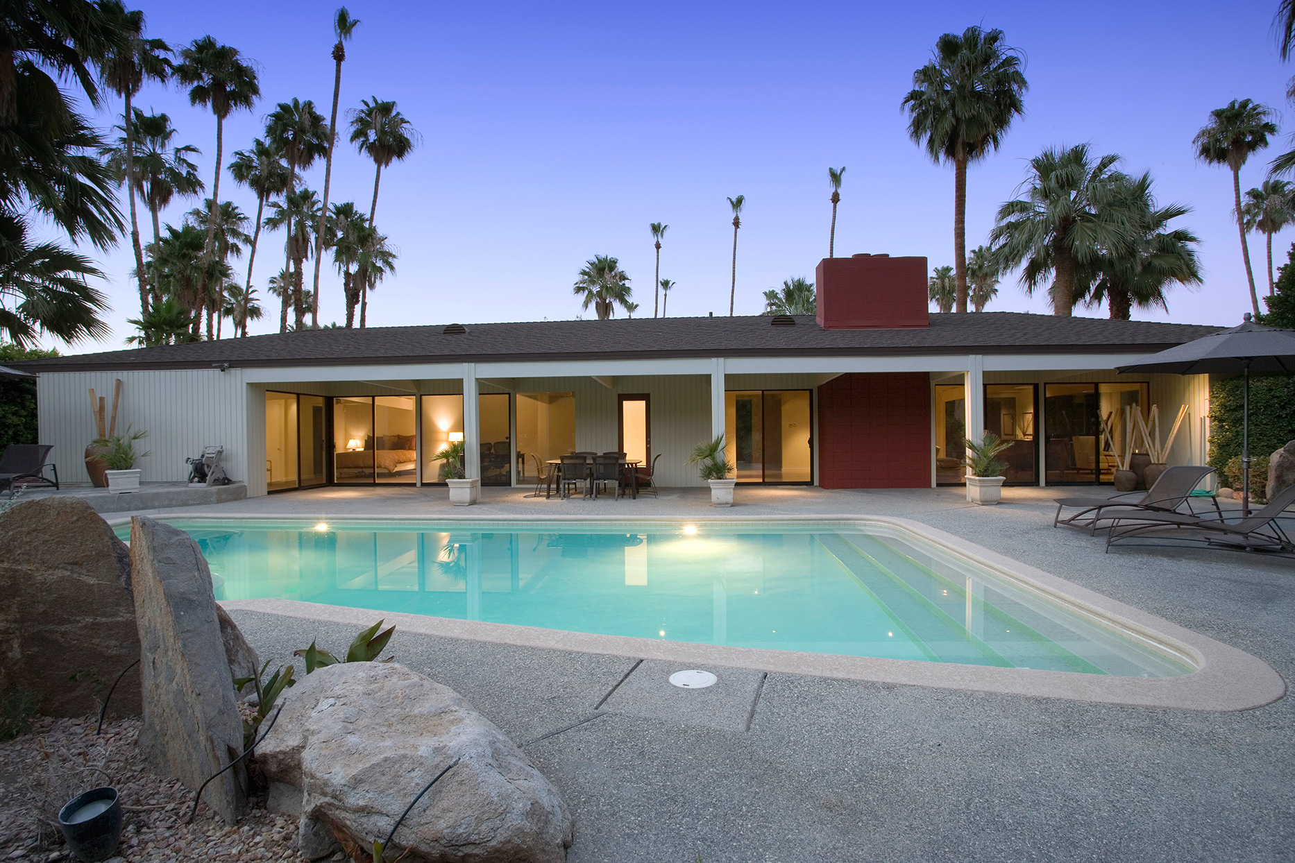 mid-century modern house with pool