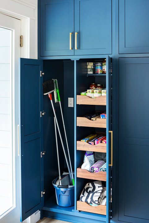 pantry organization broom closet and drawers in blue kitchen