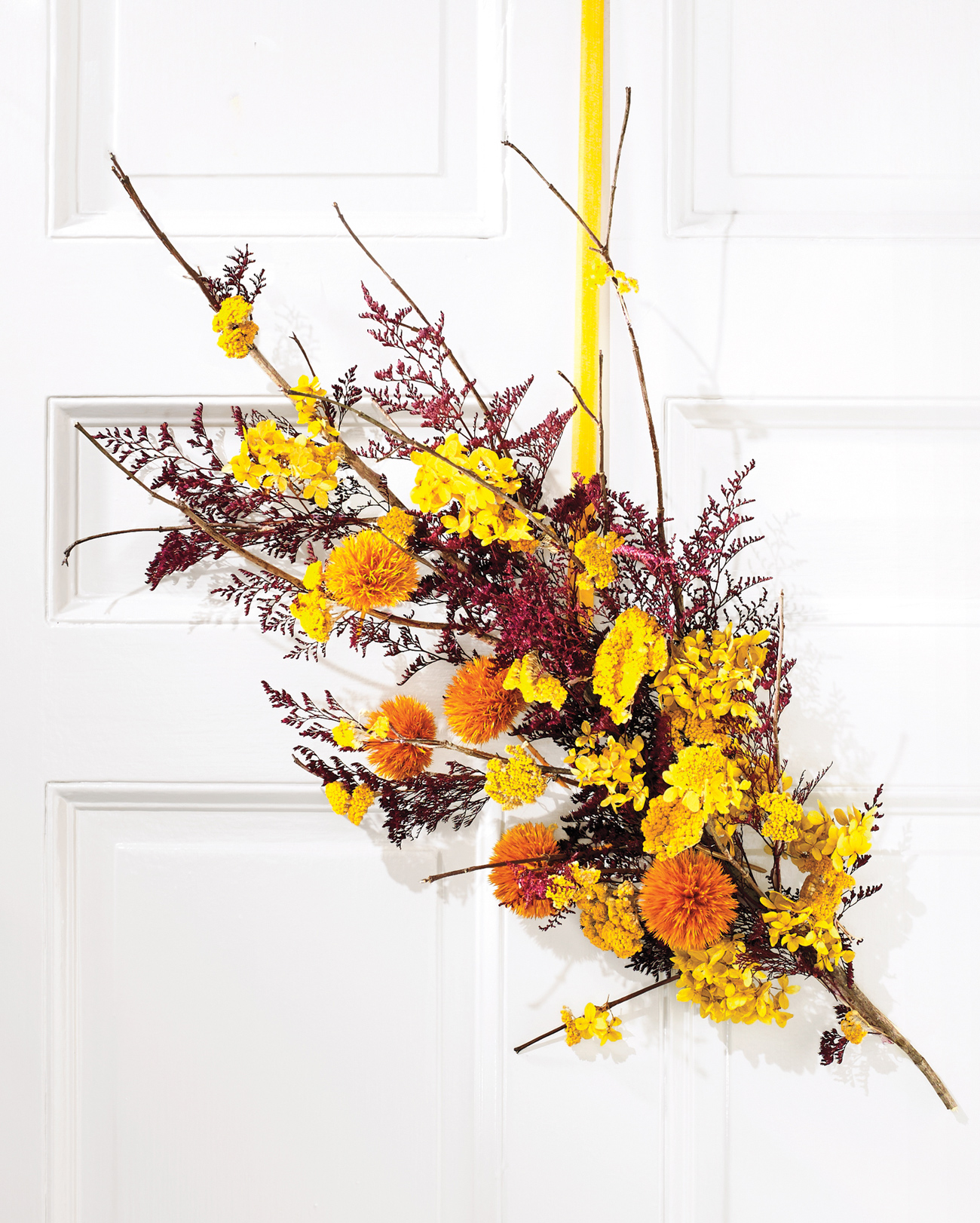fall dried floral wreath hanging on door