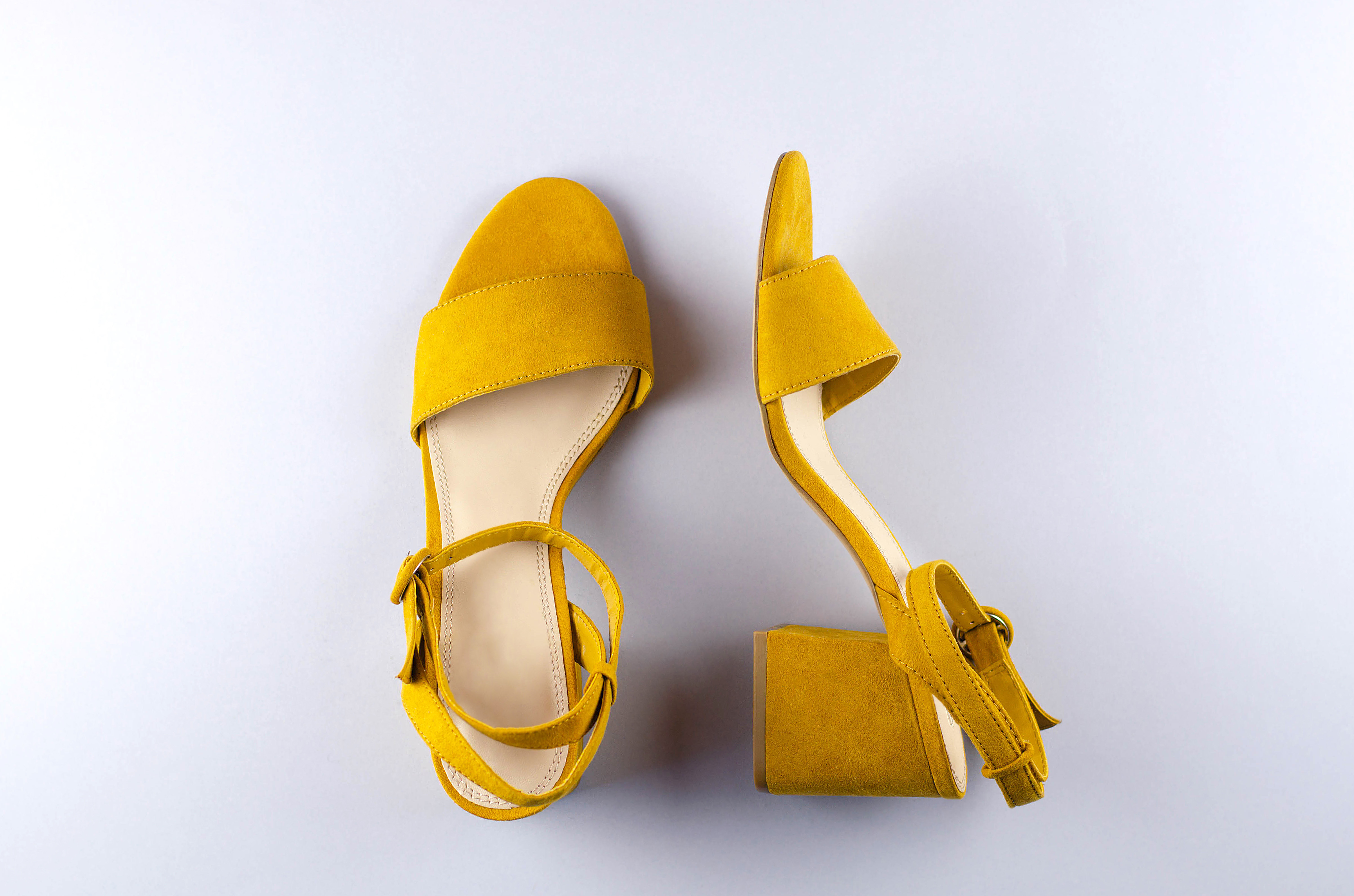 Two sandals mustard color gray background