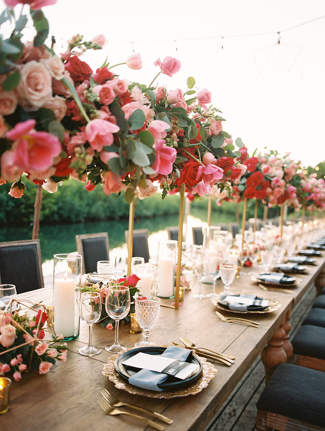 katie nick wedding reception tables with floral overhanging