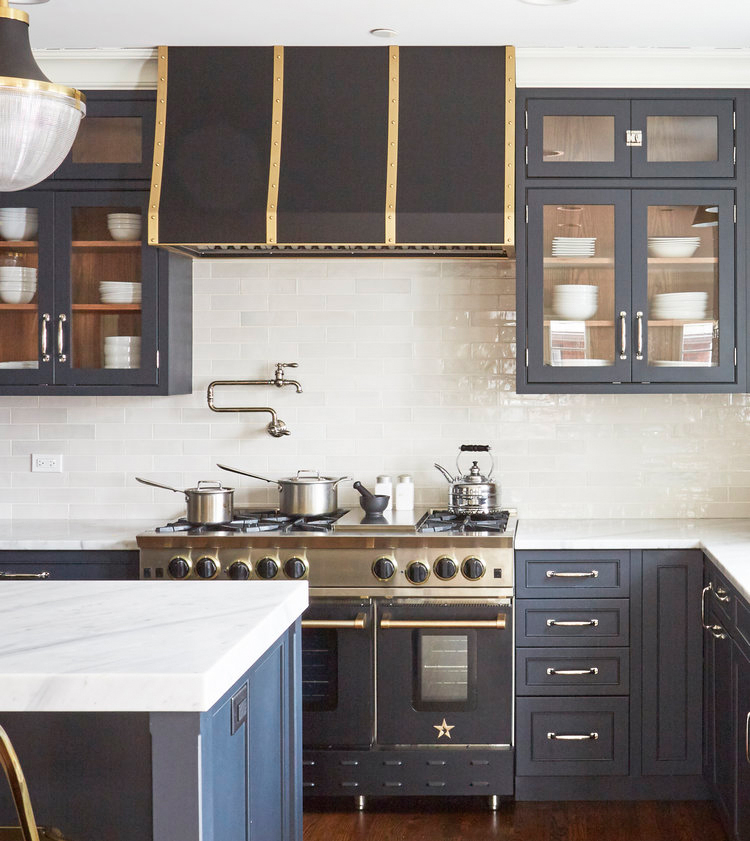 gold, navy and white kitchen with high-powered oven