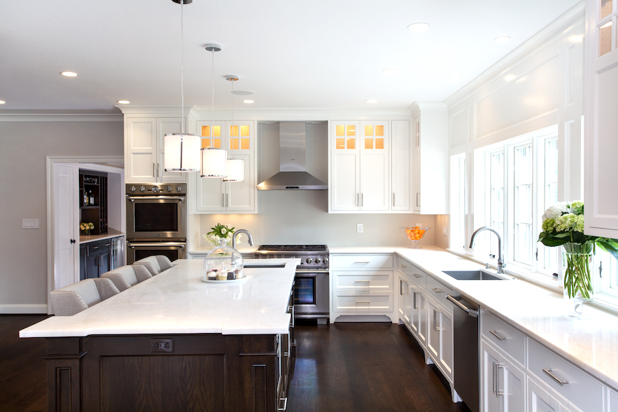 white spacious kitchen with prep sink in countertop